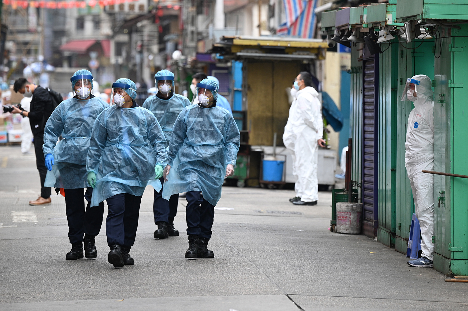 Police patrol the streets while wearing protective gear as authorities continue testing for the second day in the Jordan area of Hong Kong, on January 24.
