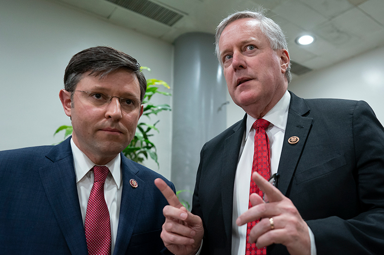 Rep. Mike Johnson, left, and Rep. Mark Meadows confer before speaking to reporters during a break in the impeachment trial on Friday, January 24.