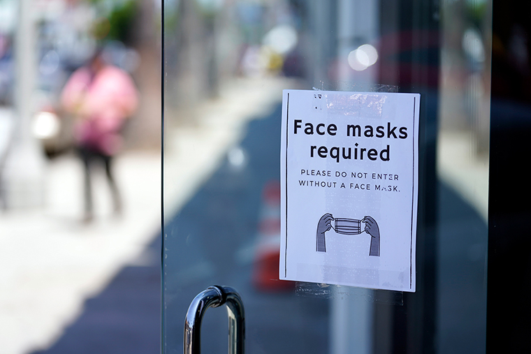 A sign on a storefront advises shoppers to wear masks inside on Monday, July 19, 2021, in the Fairfax district of Los Angeles. Los Angeles County has reinstated an indoor mask mandate due to rising COVID-19 cases.