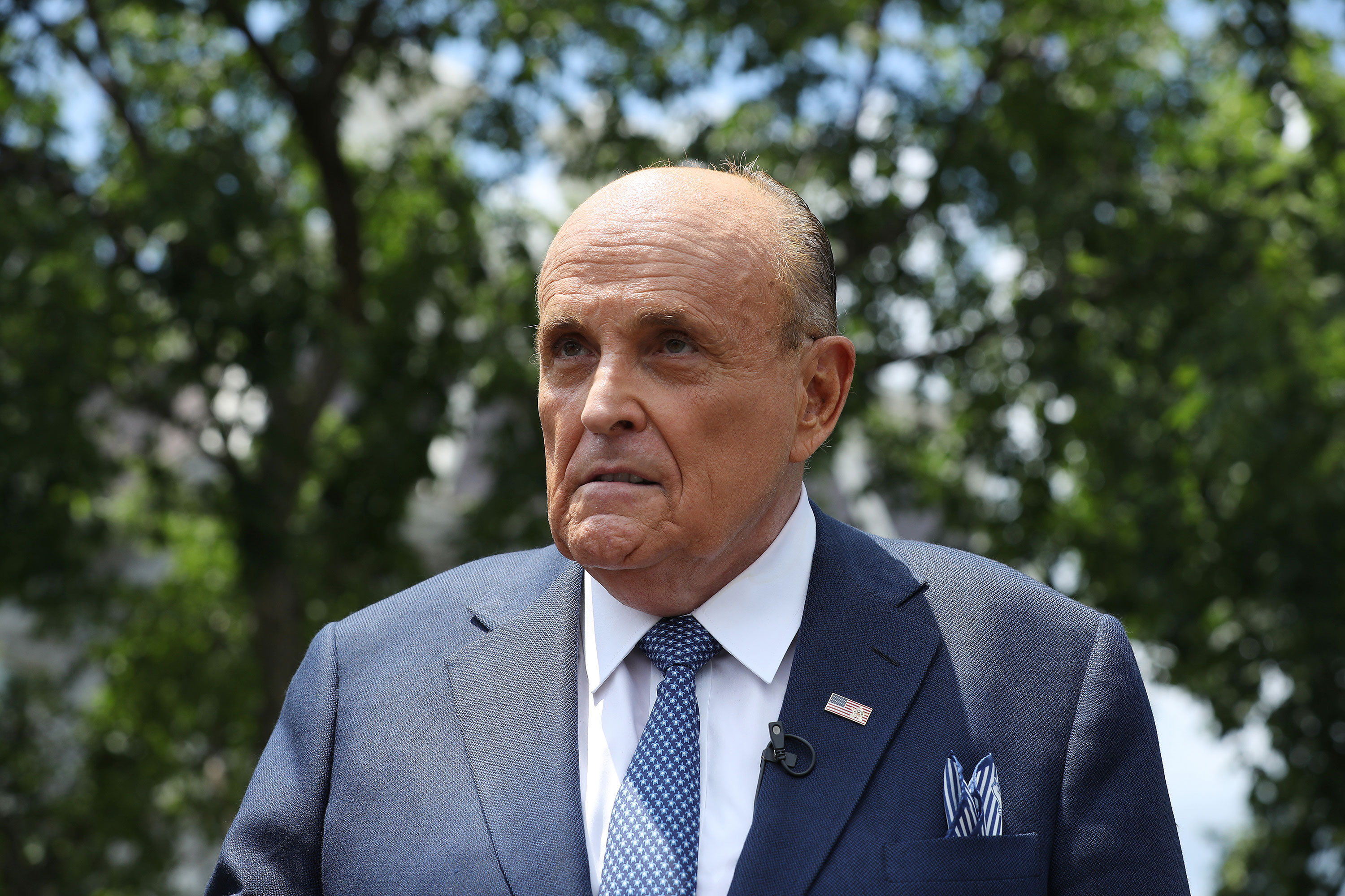 Former New York City Mayor Rudy Giuliani talks to journalists outside the White House on July 1 in Washington, DC.