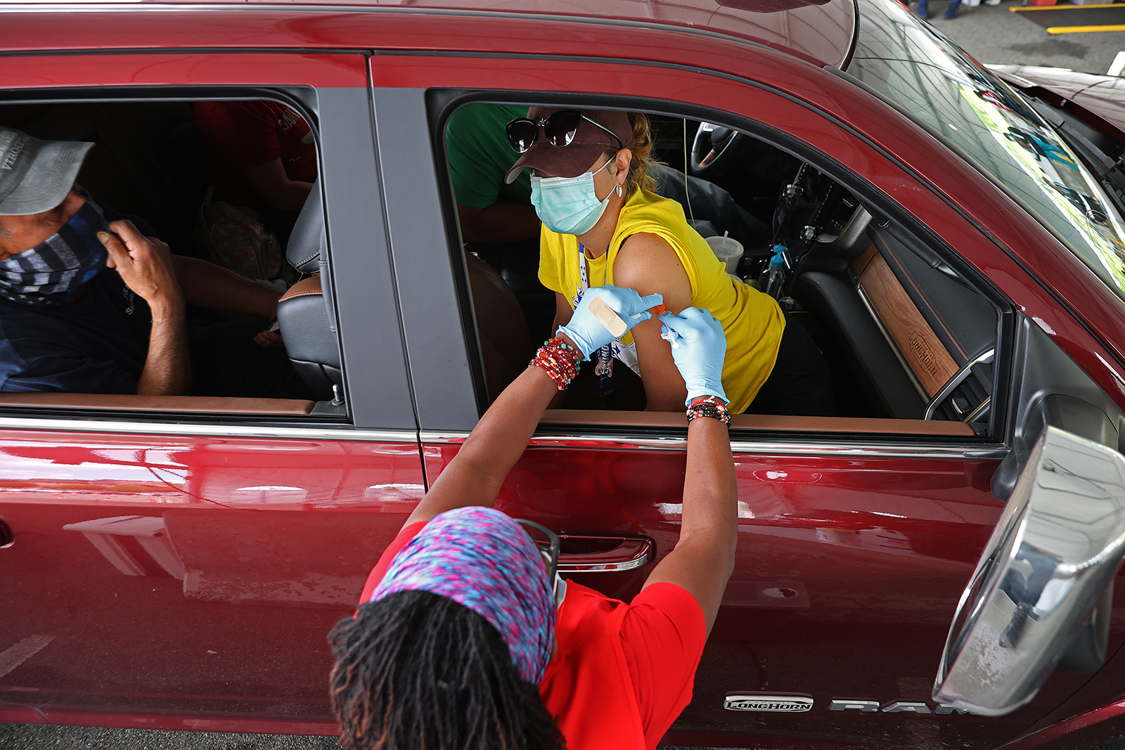 A woman receives her first dose of the Pfizer vaccine at Ripken Baseball in Aberdeen, Maryland, on May 05.