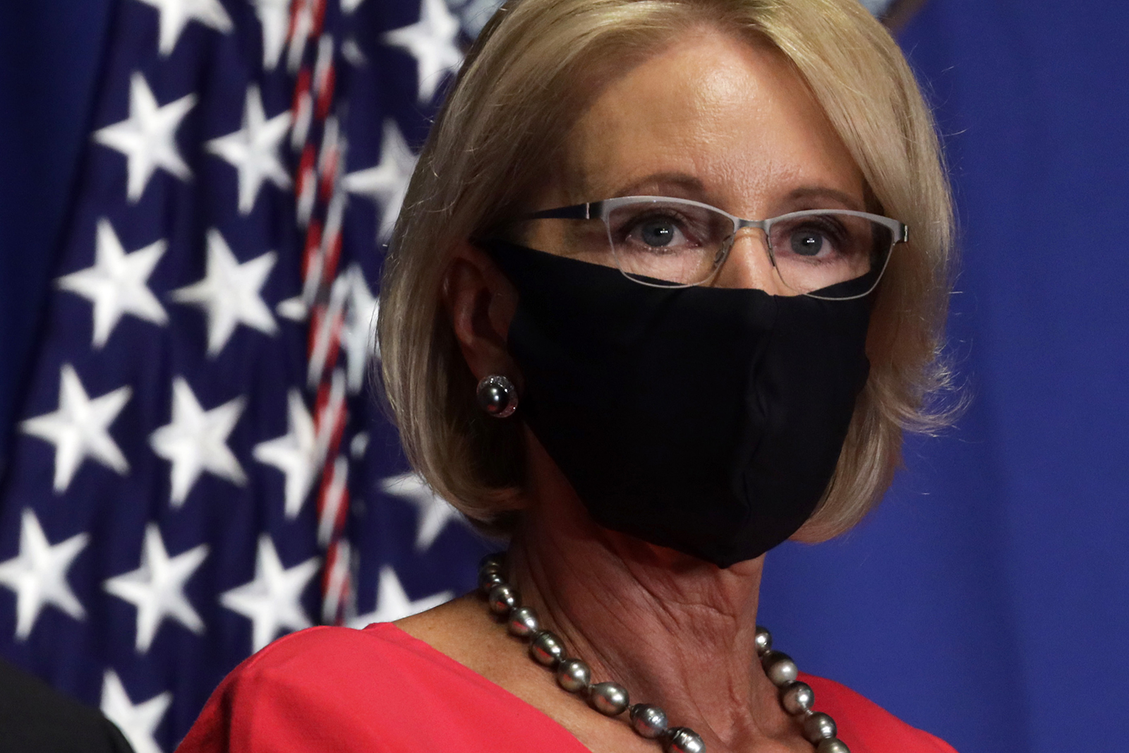 Secretary of Education Betsy DeVos listens during a White House Coronavirus Task Force press briefing at the U.S. Department of Education July 8 in Washington.