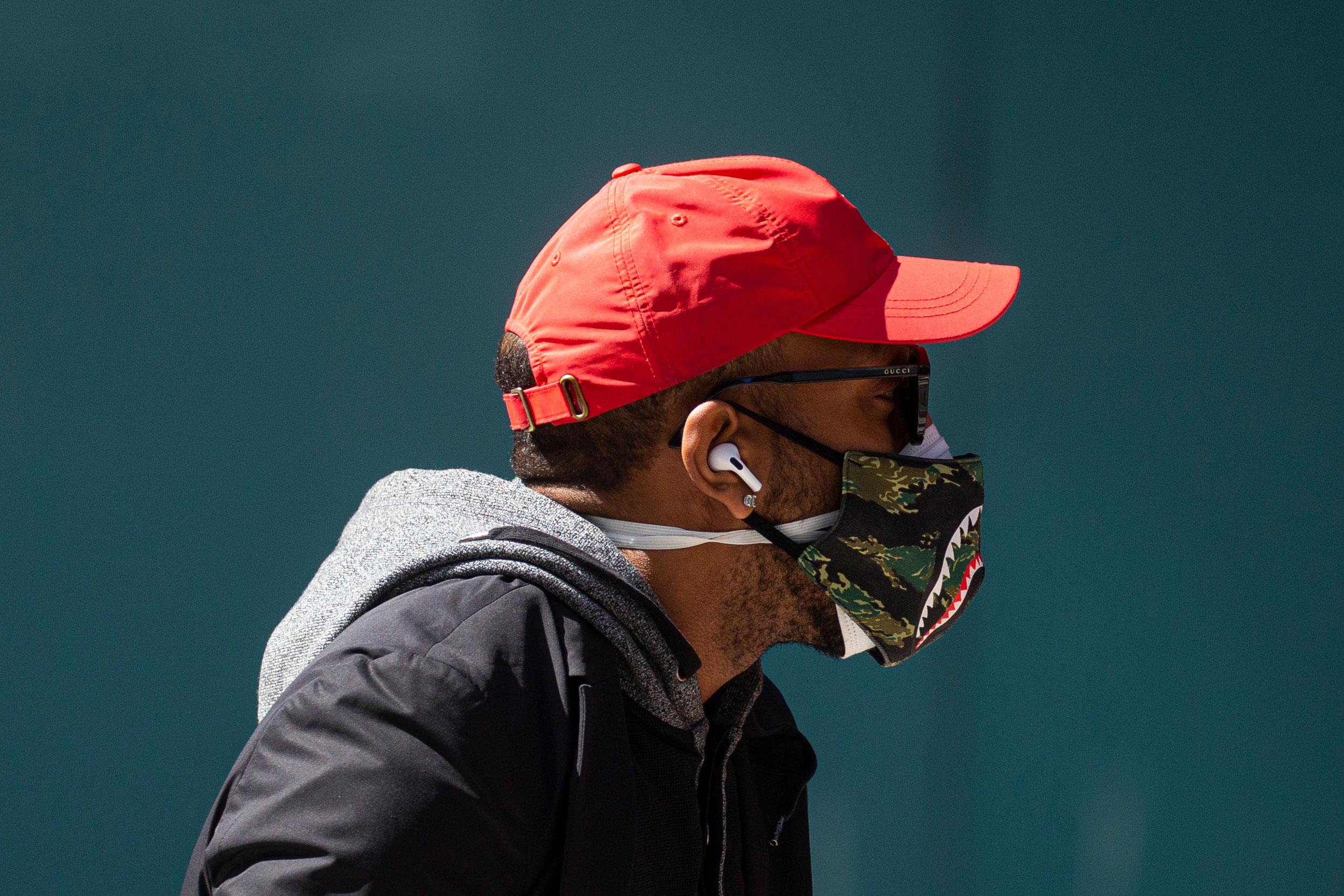 A man wears two masks as he walks in Times Square in New York on April 6.