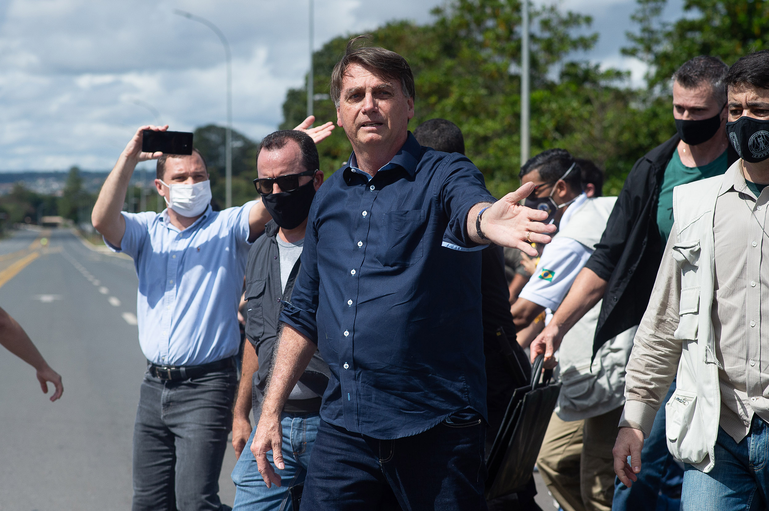 Brazilian President Jair Bolsonaro reacts during a demonstration in favor of his government amidst the coronavirus pandemic in front of the Planalto Palace in Brasilia, Brazil, on Sunday, May 24.