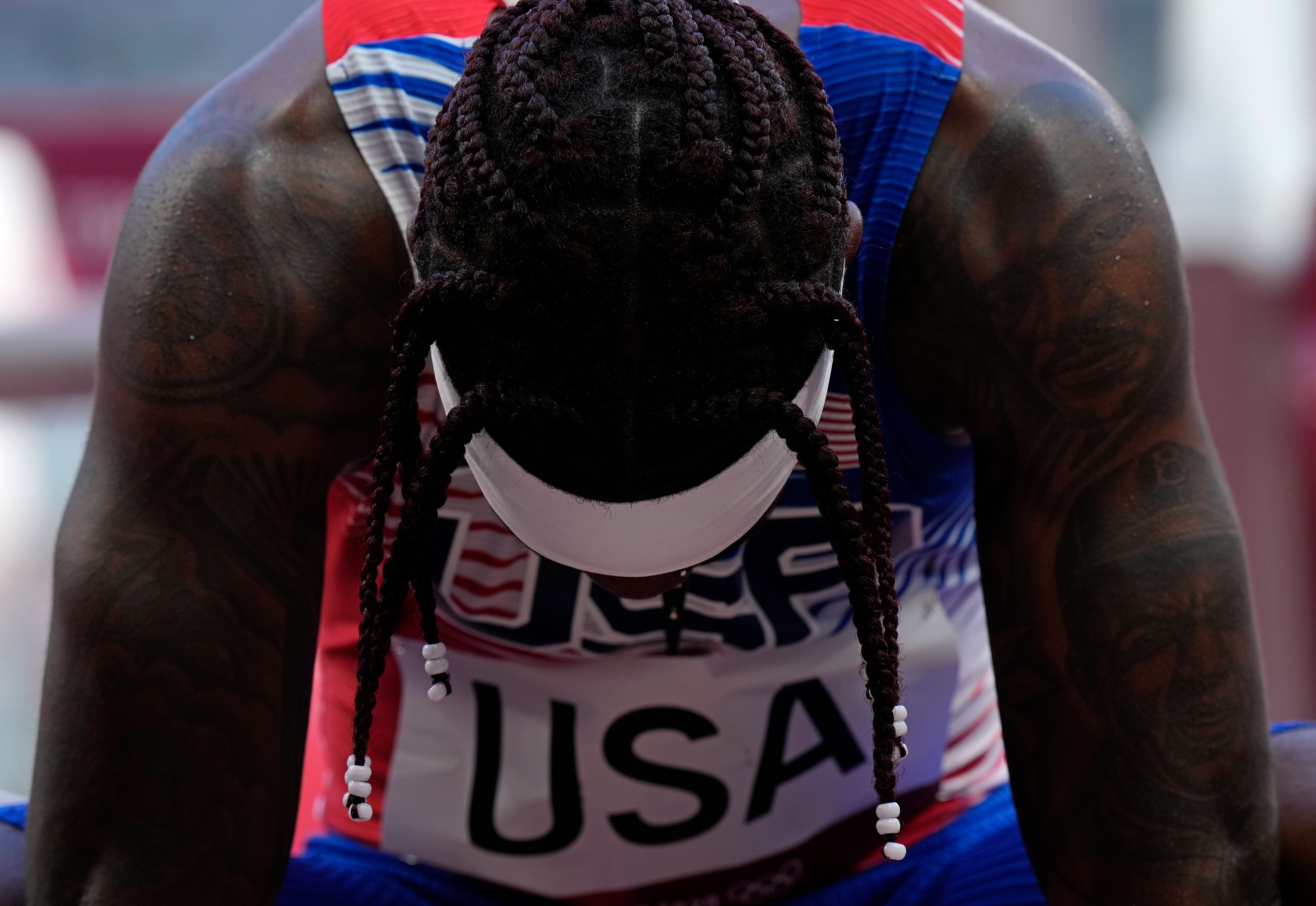 The United States' Cravon Gillespie reacts after finishing sixth in a 4x100-meter relay heat on August 5.