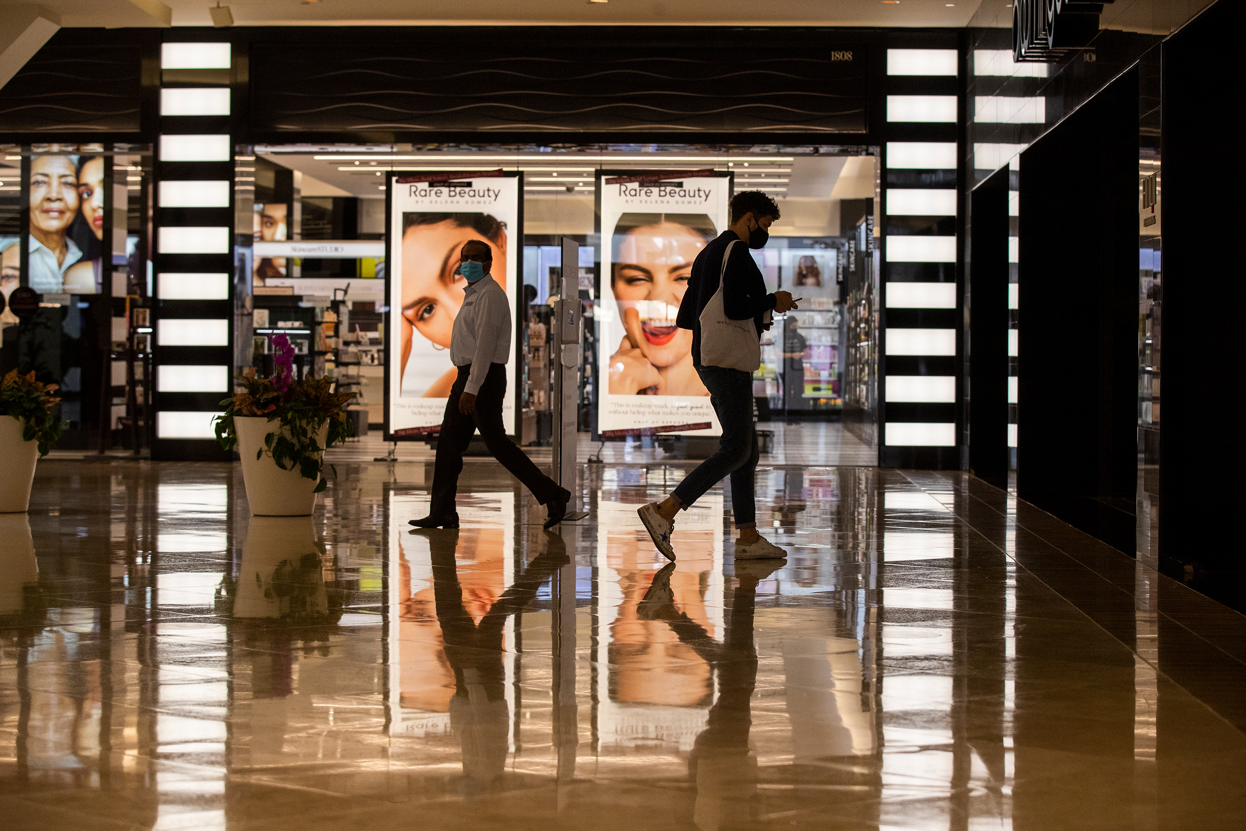 People visit South Coast Plaza in Costa Mesa, California, on September 28.