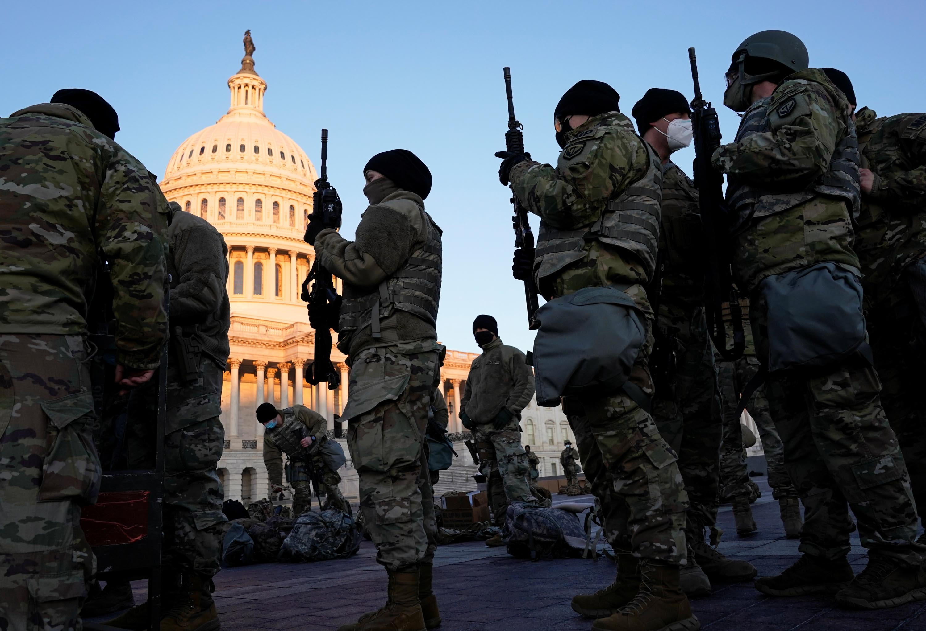 Members of the National Guard are given weapons before Democrats begin debating one article of impeachment against President Trump, outside the US Capitol in Washington, DC, on Wednesday, January 13.