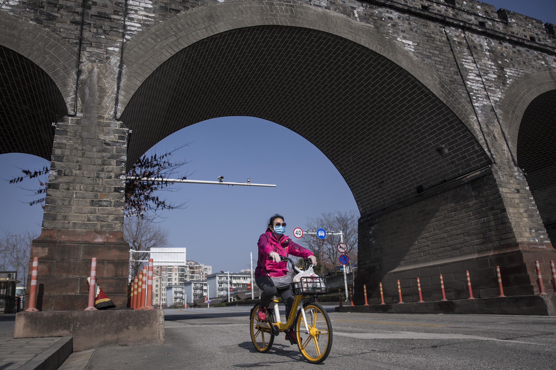 A women biking in Wuhan, China, on February 9.