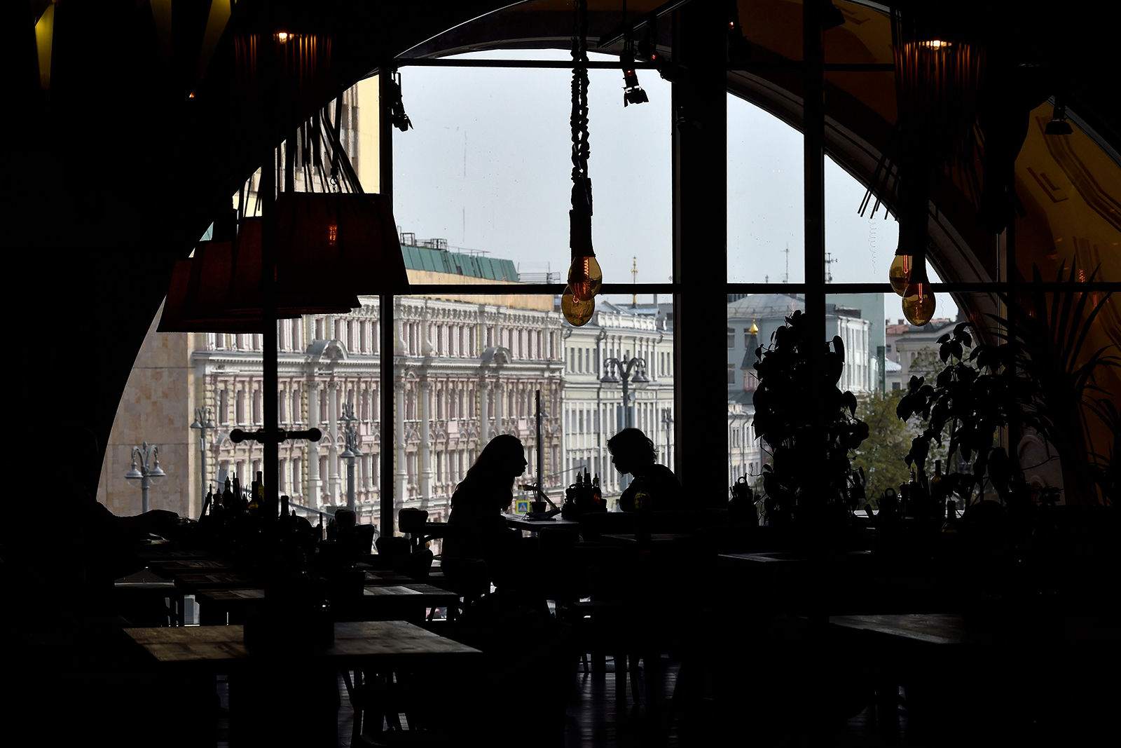 Women eat lunch in an almost empty restaurant in Moscow on September 29.