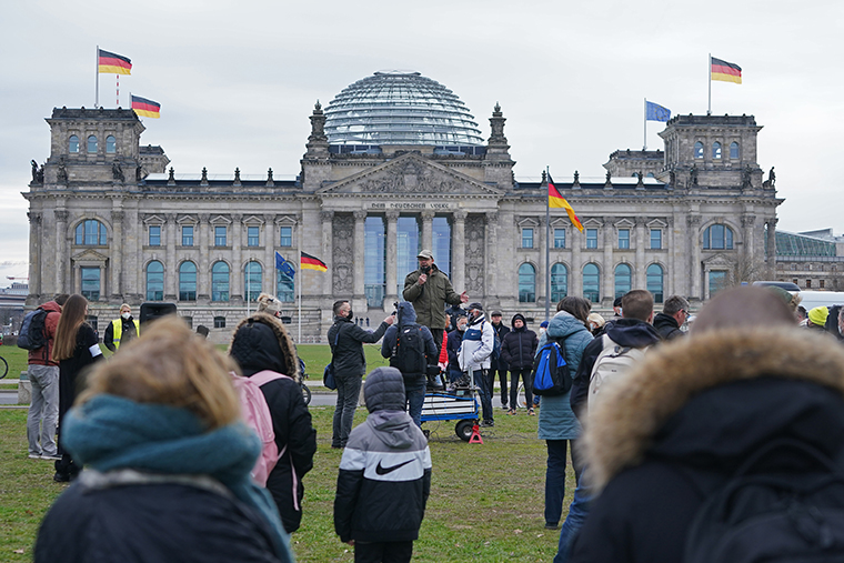 Protesters gathered outside the Reichstag on April 16, 2021 where the Bundestag was in session for the first reading of new measures to rein in the spread of the coronavirus, in Berlin, Germany.
