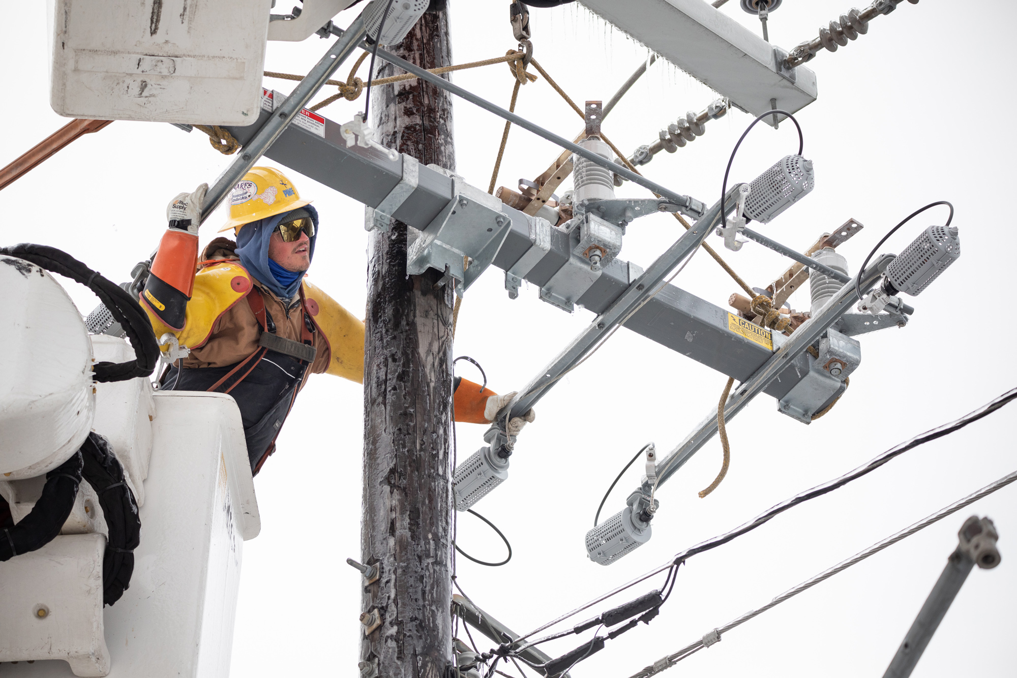 A worker repairs a power line in Austin, Texas, on February 18.