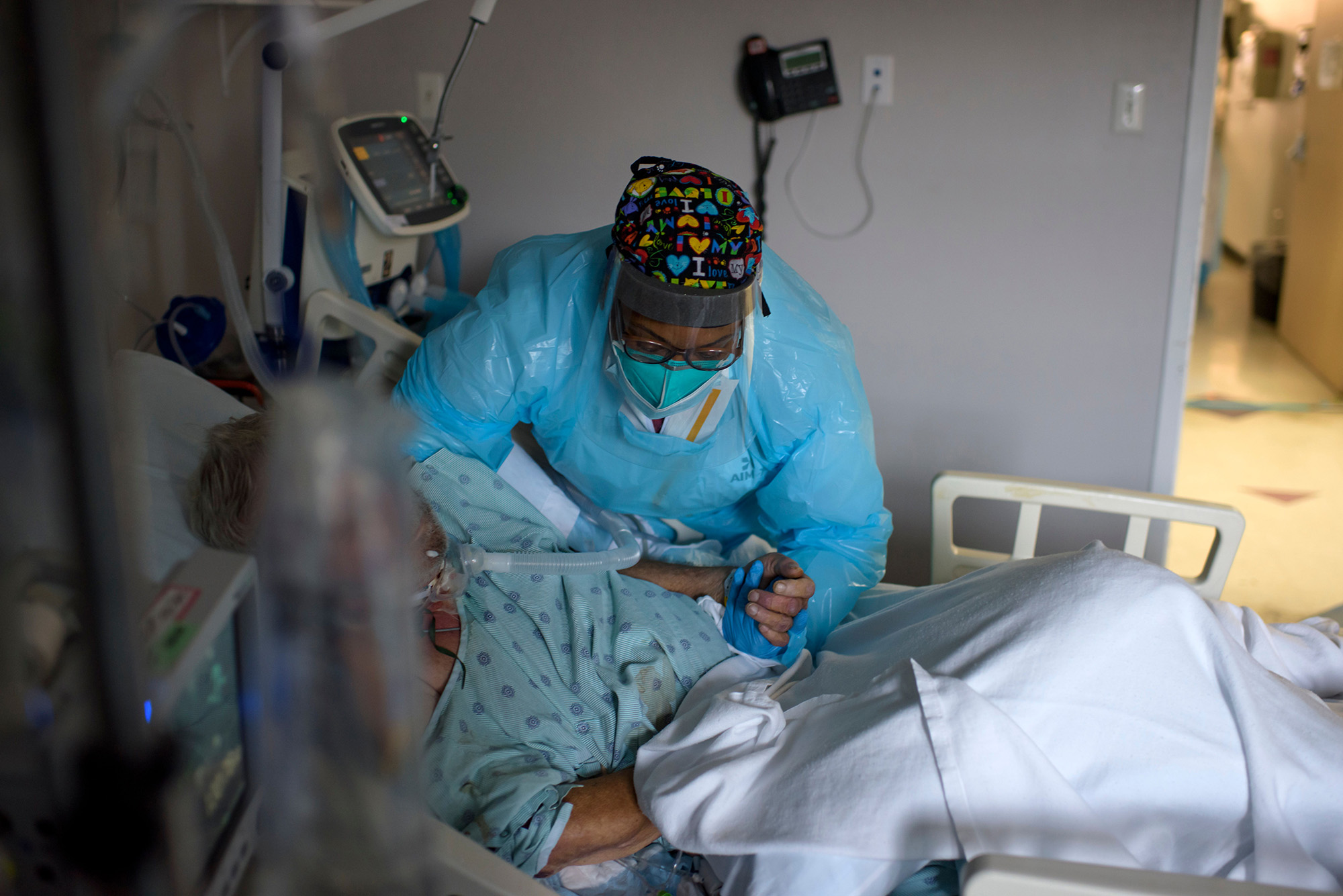 Health care worker Demetra Ransom comforts a patient in the Covid-19 ward at United Memorial Medical Center in Houston, Texas, on December 4.