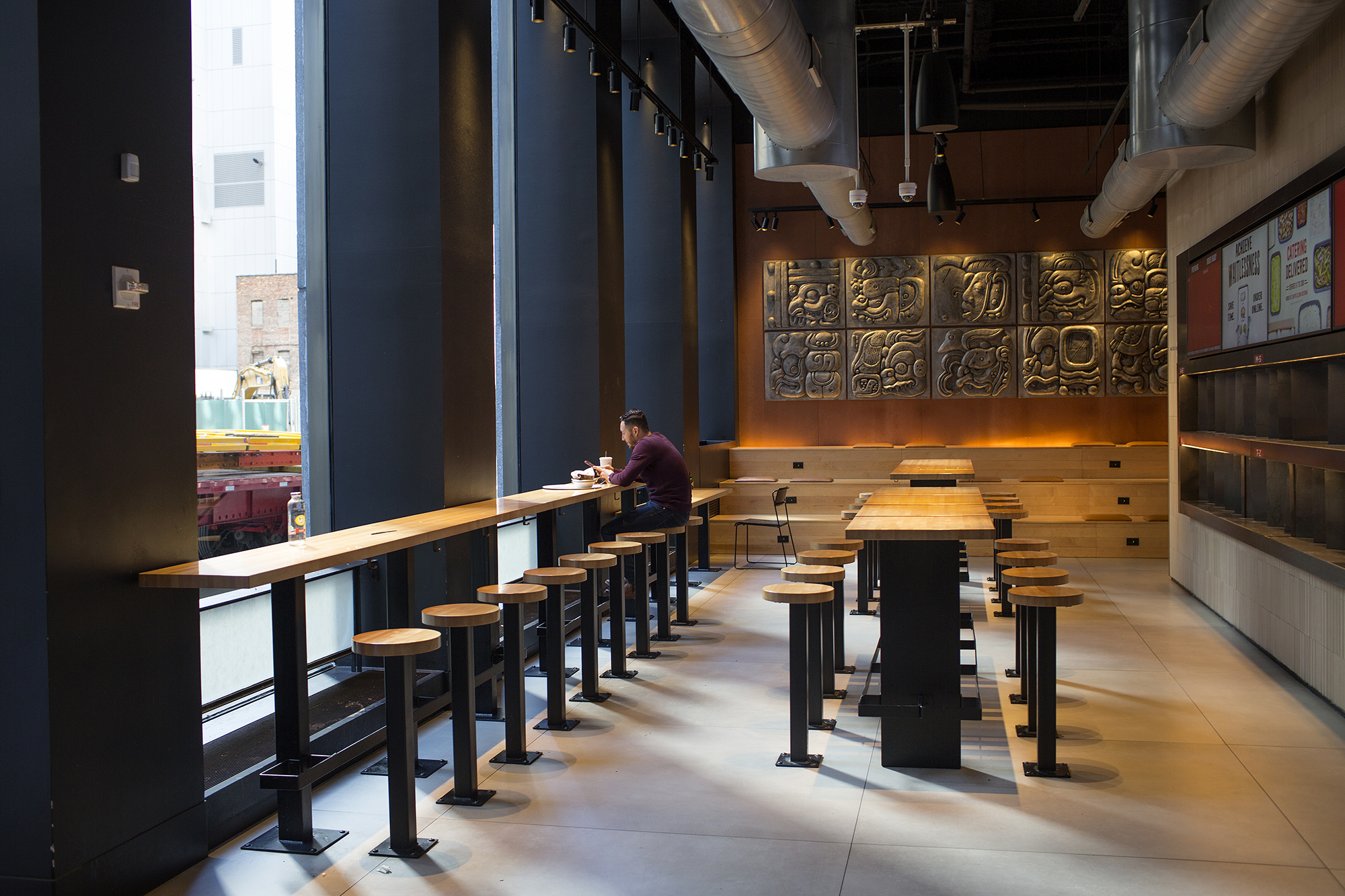 A man eats lunch in a deserted restaurant on Saturday, March 14, in New York City.