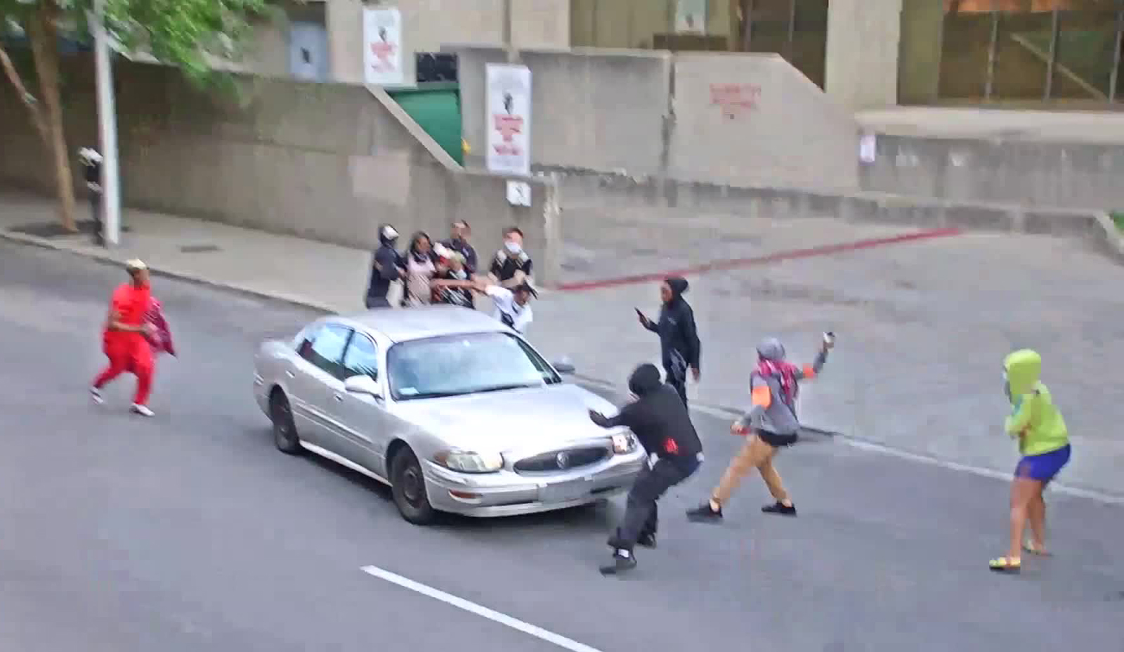 Protesters engage with a car in Louisville, Kentucky.