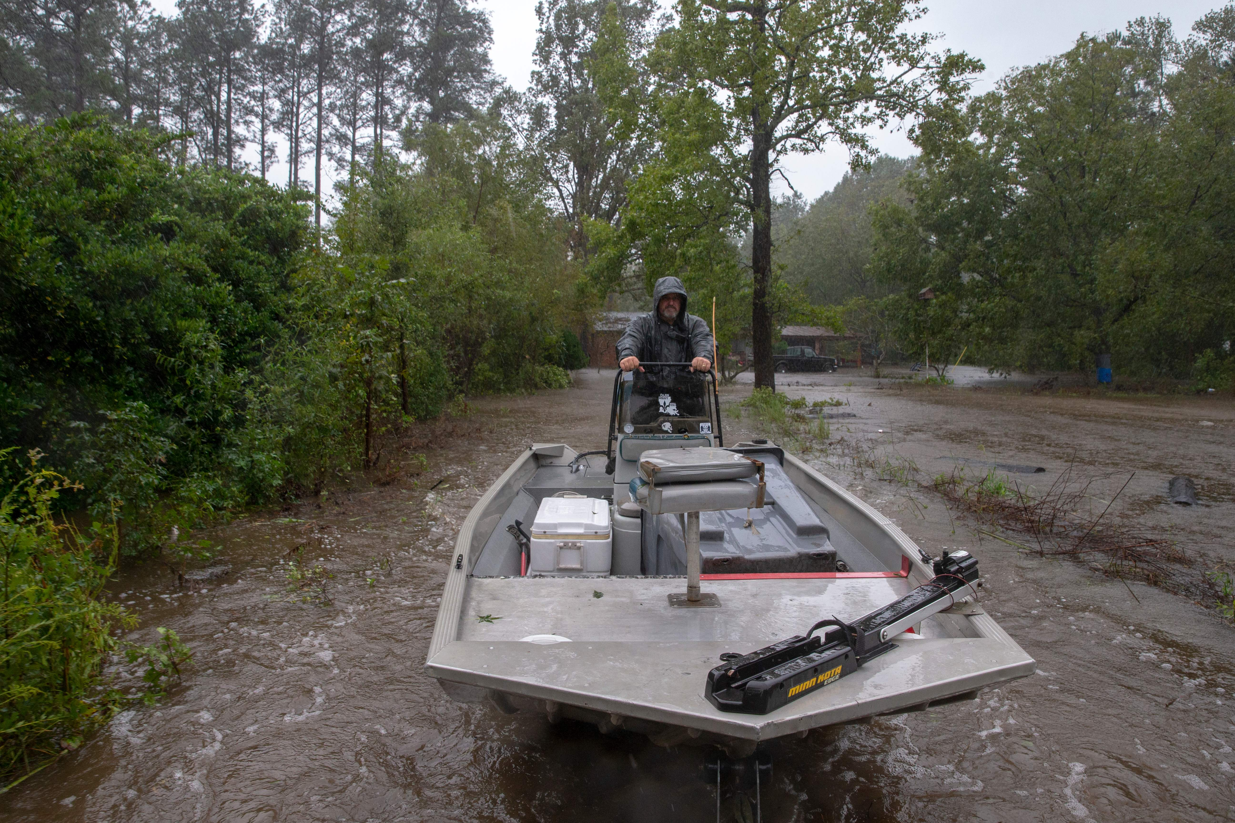 Rescuer John Bridges with the Cajun Navy rides a boat on a trailer after completing a rescue in Lumberton, North Carolina, in 2018 in the wake of Hurricane Florence.