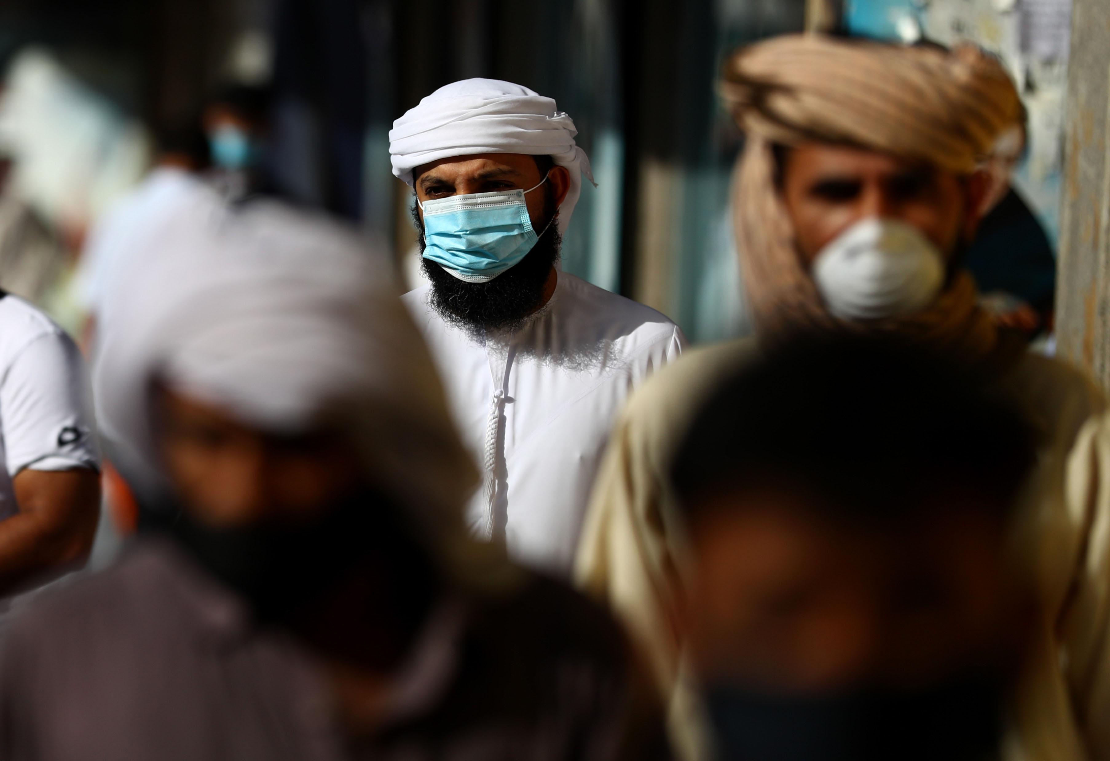 People walk in Dubai, United Arab Emirates, on May 5.
