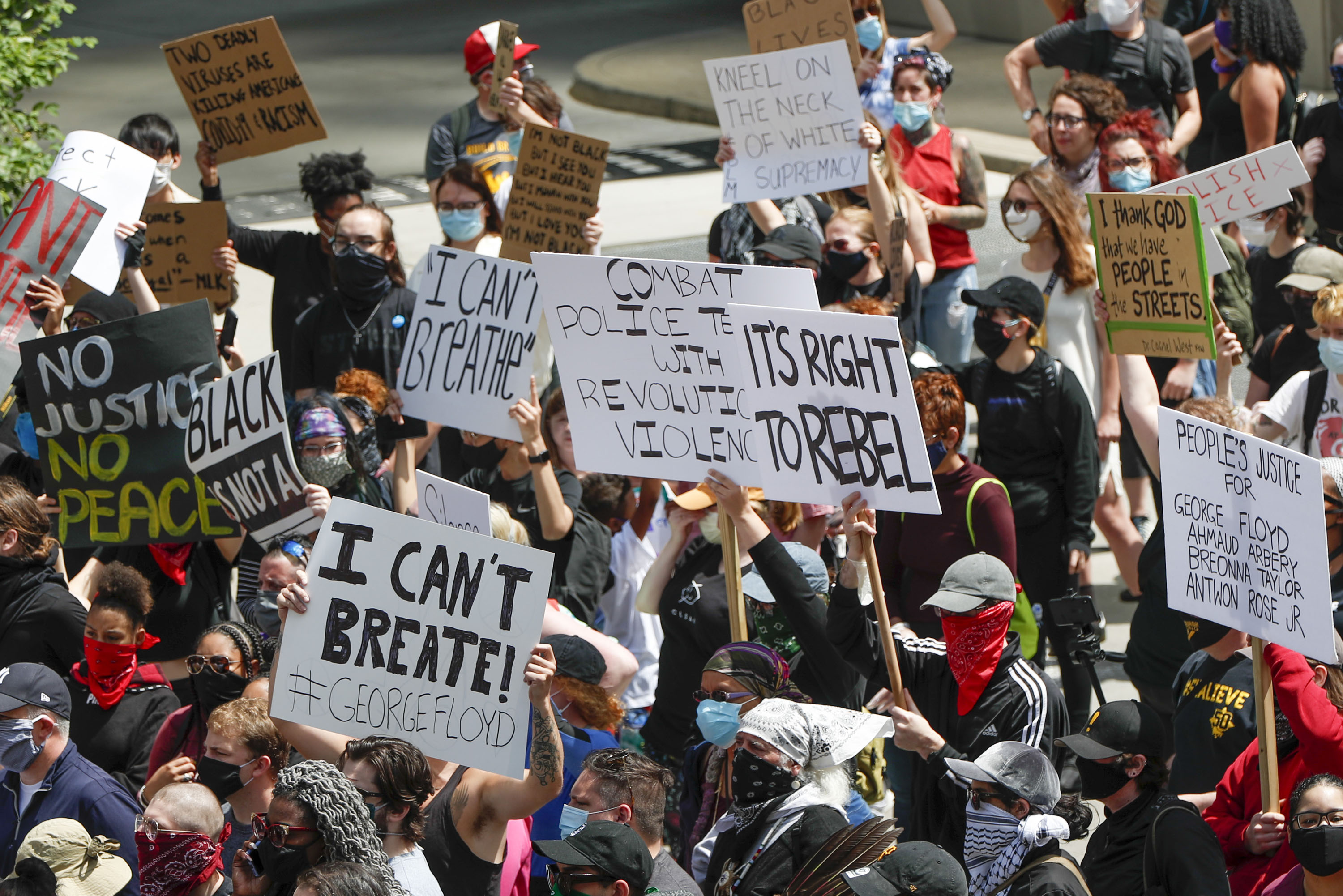 Demonstrators gather in a street during a march in Pittsburgh on May 30.