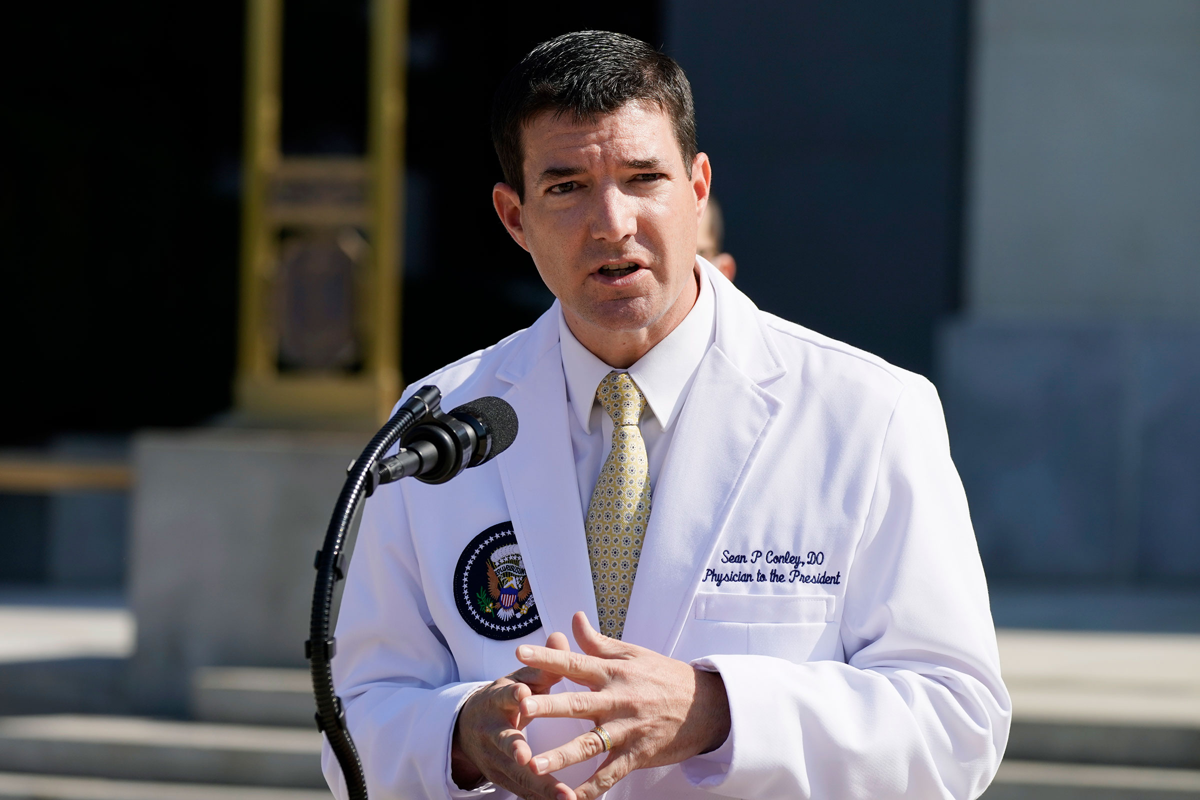 White House physician Sean Conley briefs reporters at Walter Reed National Military Medical Center in Bethesda, Maryland, on October 4.