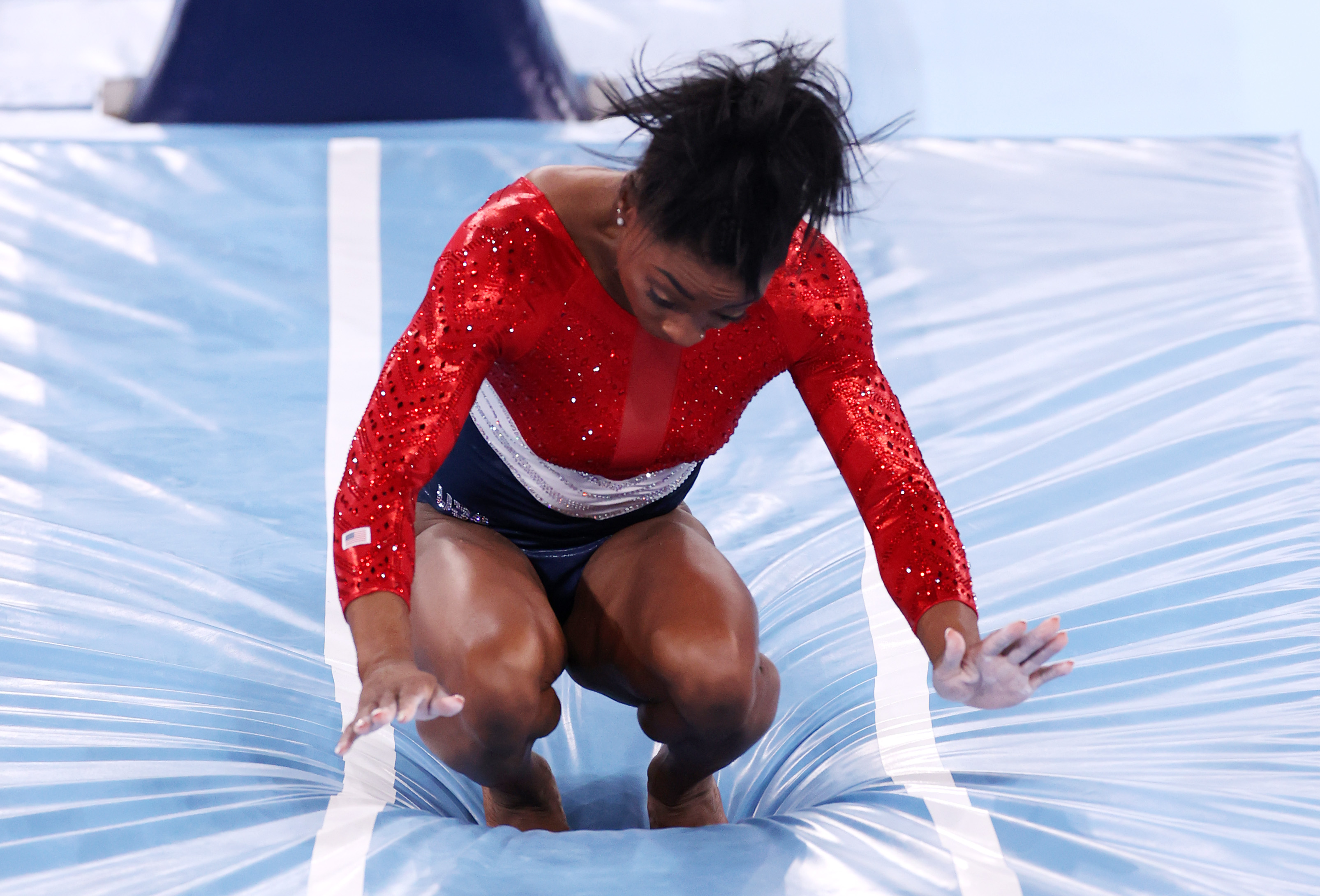 Simone Biles stumbles upon landing after competing in vault on July 27.
