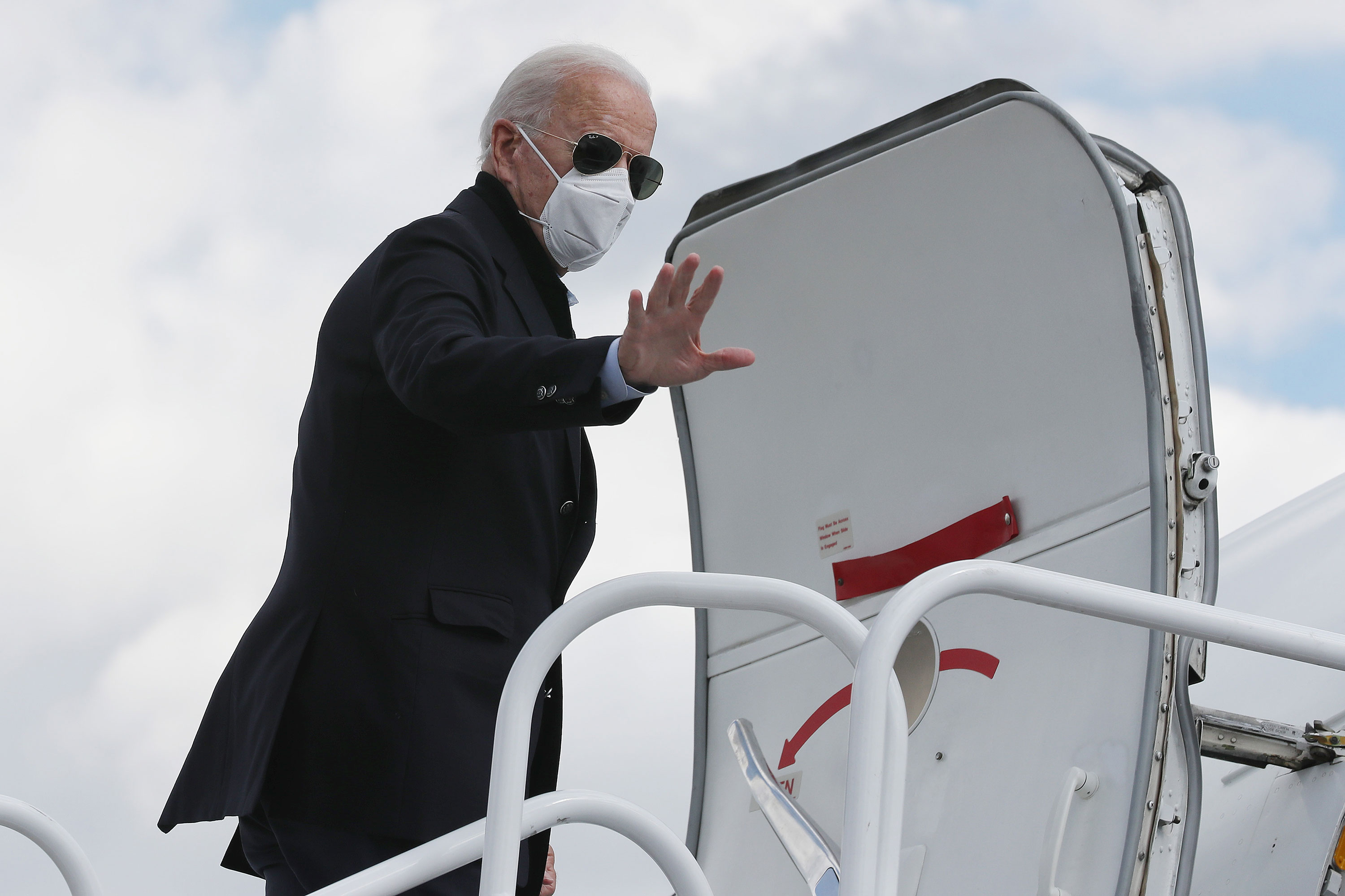 Former Vice President Joe Biden boards his campaign plane in New Castle, Delaware, before traveling to Grand Rapids, Michigan, on October 2.