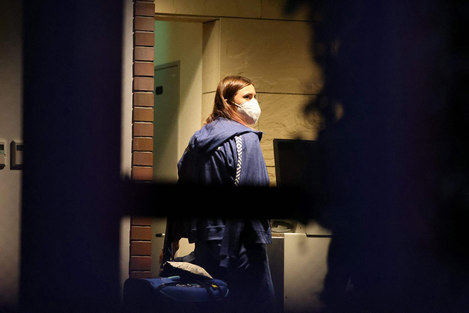 Belarus athlete Kristina Timanovskaya walks with her luggage inside the Polish embassy in Tokyo on August 2.