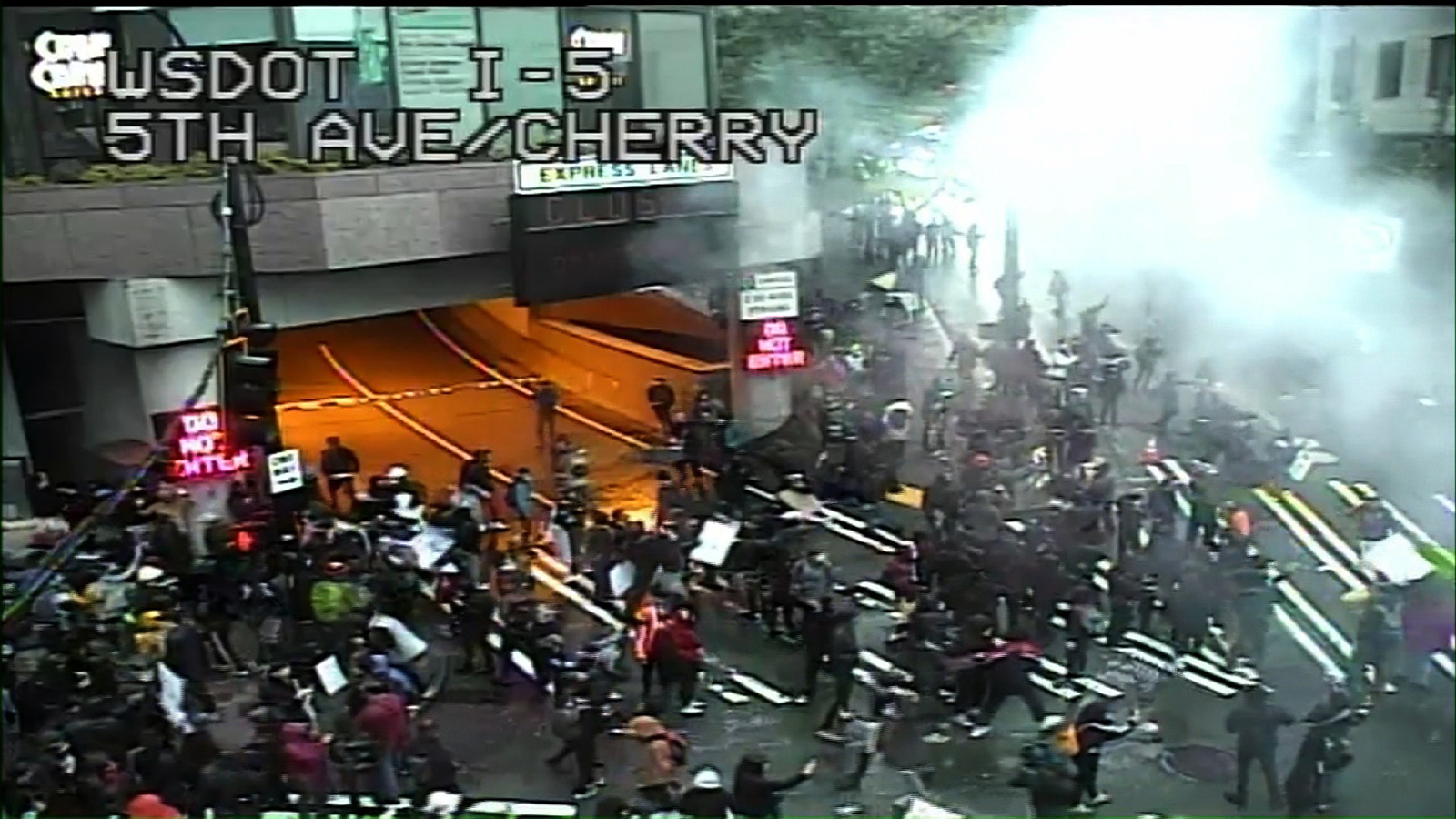 Protesters march through the streets of Seattle, on May 30.