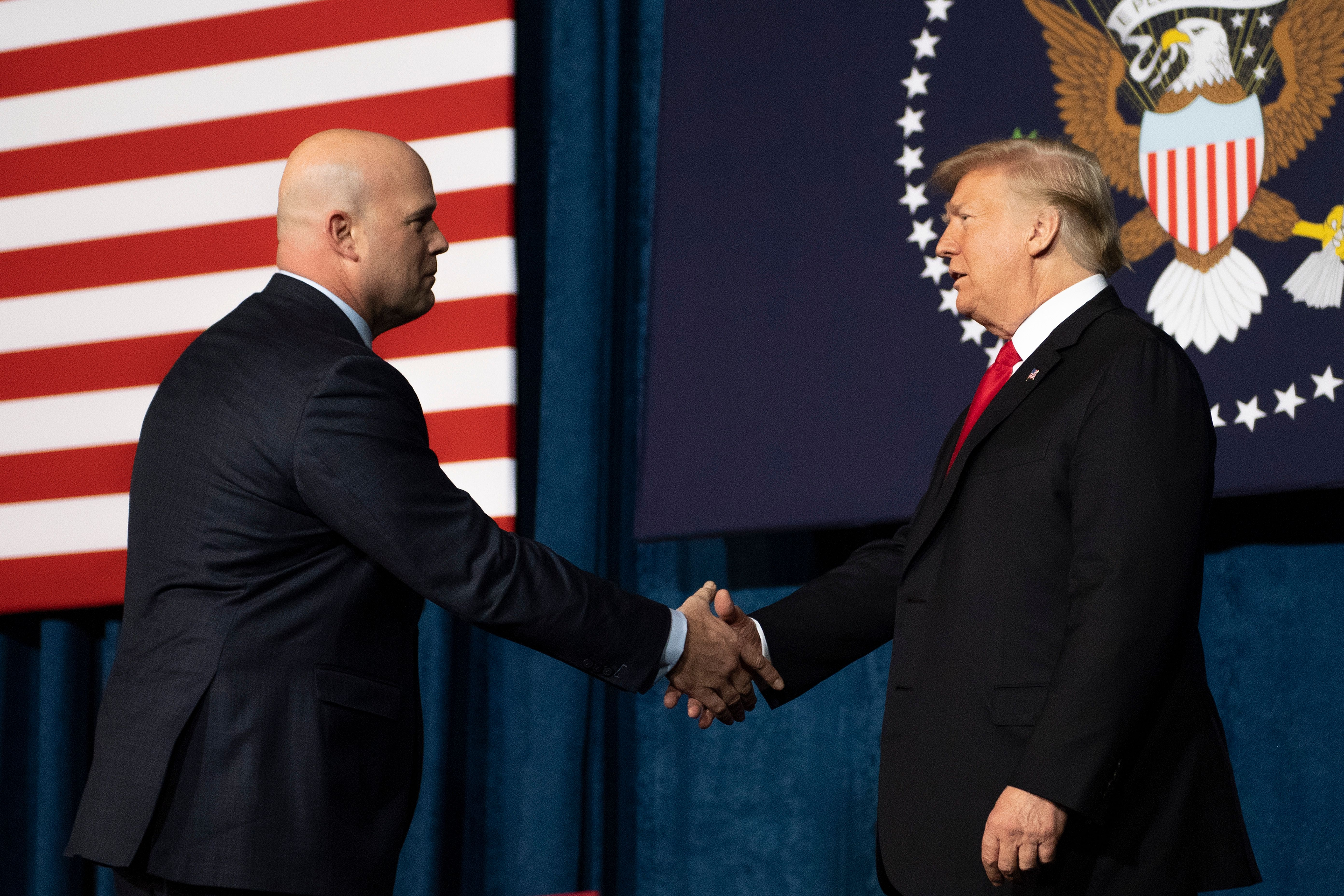 President Trump shakes hands with Acting US Attorney General Matt Whitaker