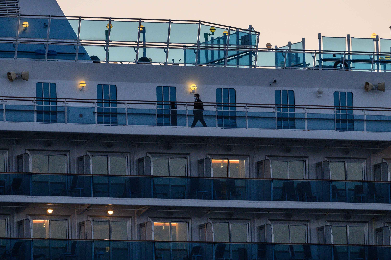 A crew member is seen aboard the quarantined Diamond Princess cruise ship at Daikoku pier cruise terminal in Yokohama, Japan on February 24.