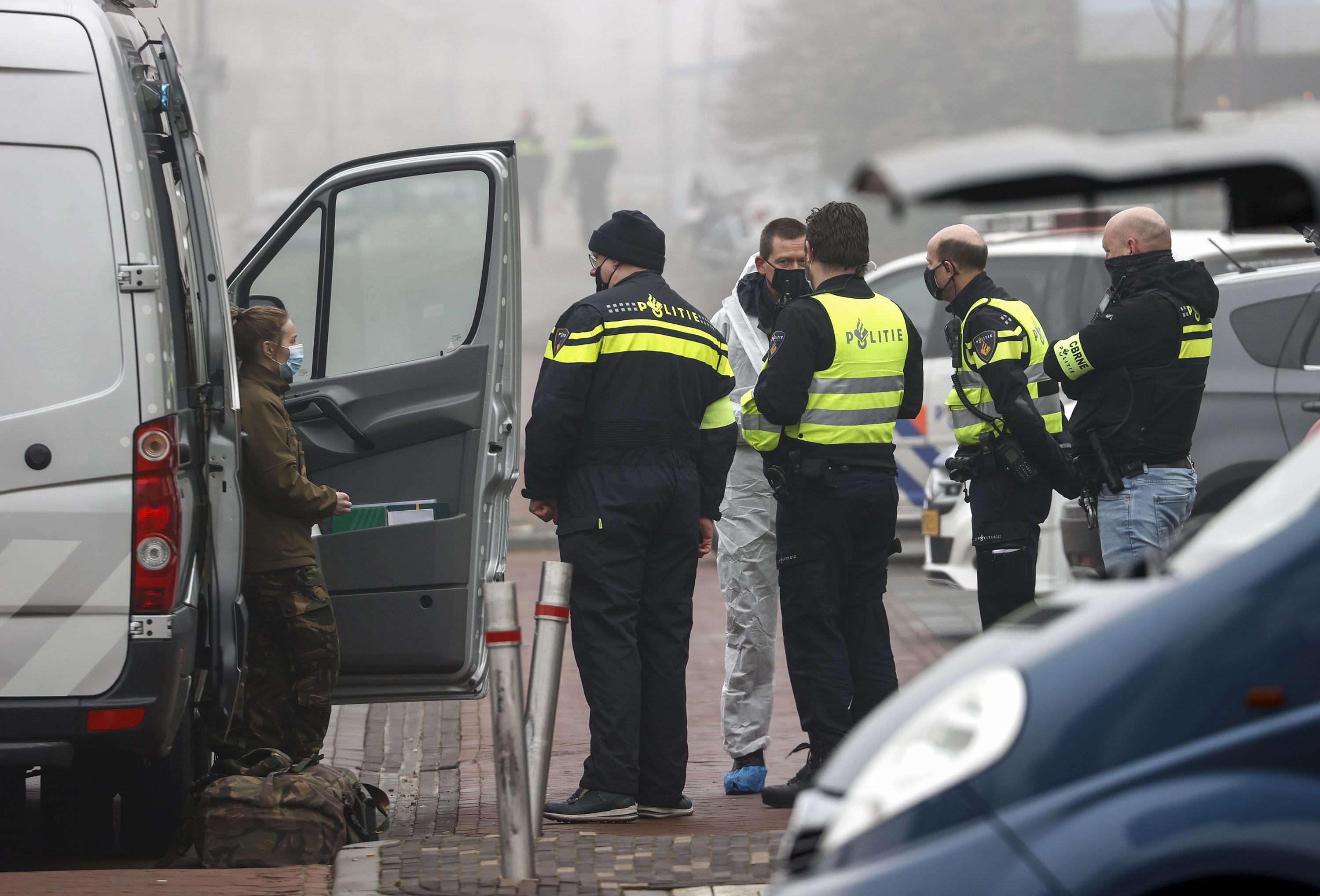 Police officers stand in a street after an explosion occurred near a Covid-19 test center in Bovenkarspel, the Netherlands, on March 3.