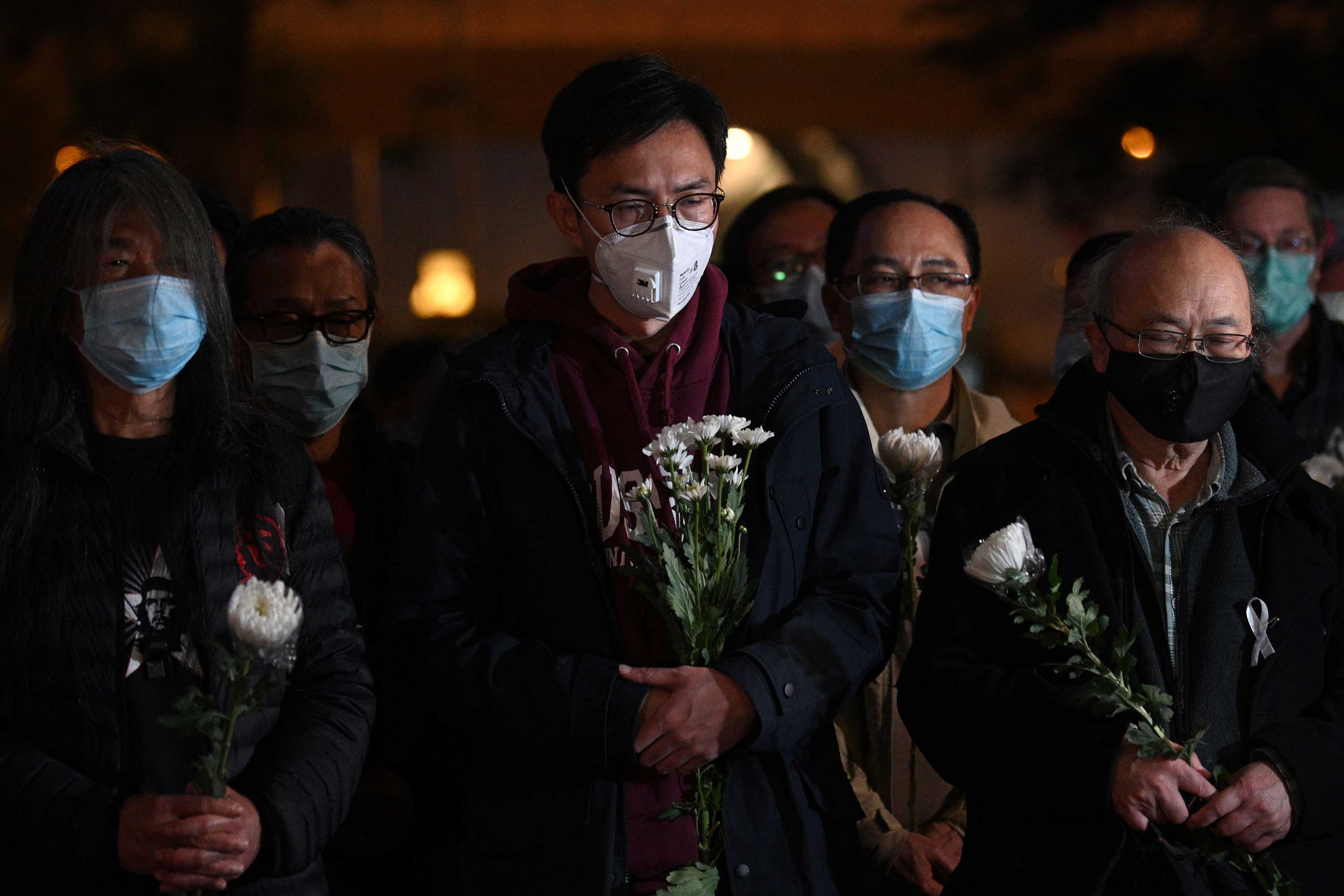 People attend a vigil for Doctor Li Wenliang in Hong Kong on Friday.