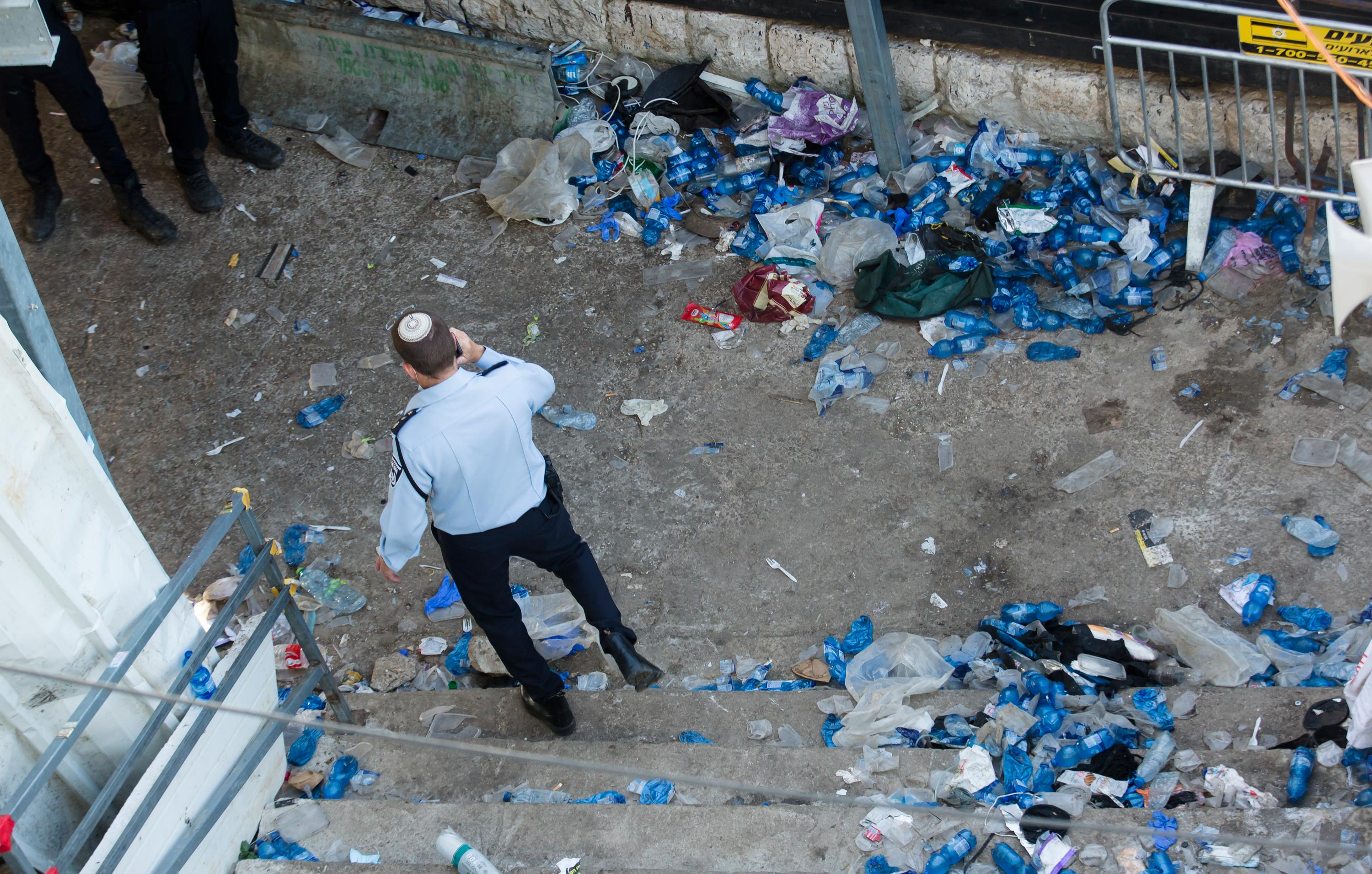 A police officer walks at the scene in Mount Meron on April 30 in Meron, Israel.