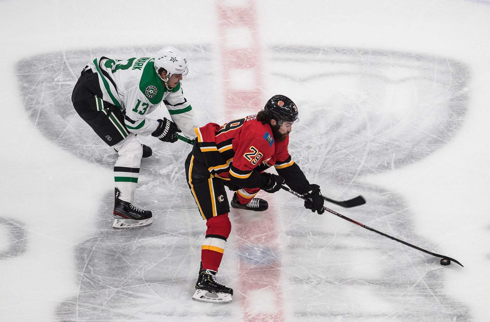 Calgary Flames' Dillon Dube is chased by Dallas Stars' Mattias Janmark during second-period NHL Western Conference Stanley Cup hockey playoff action in Edmonton, Alberta, on August 16.