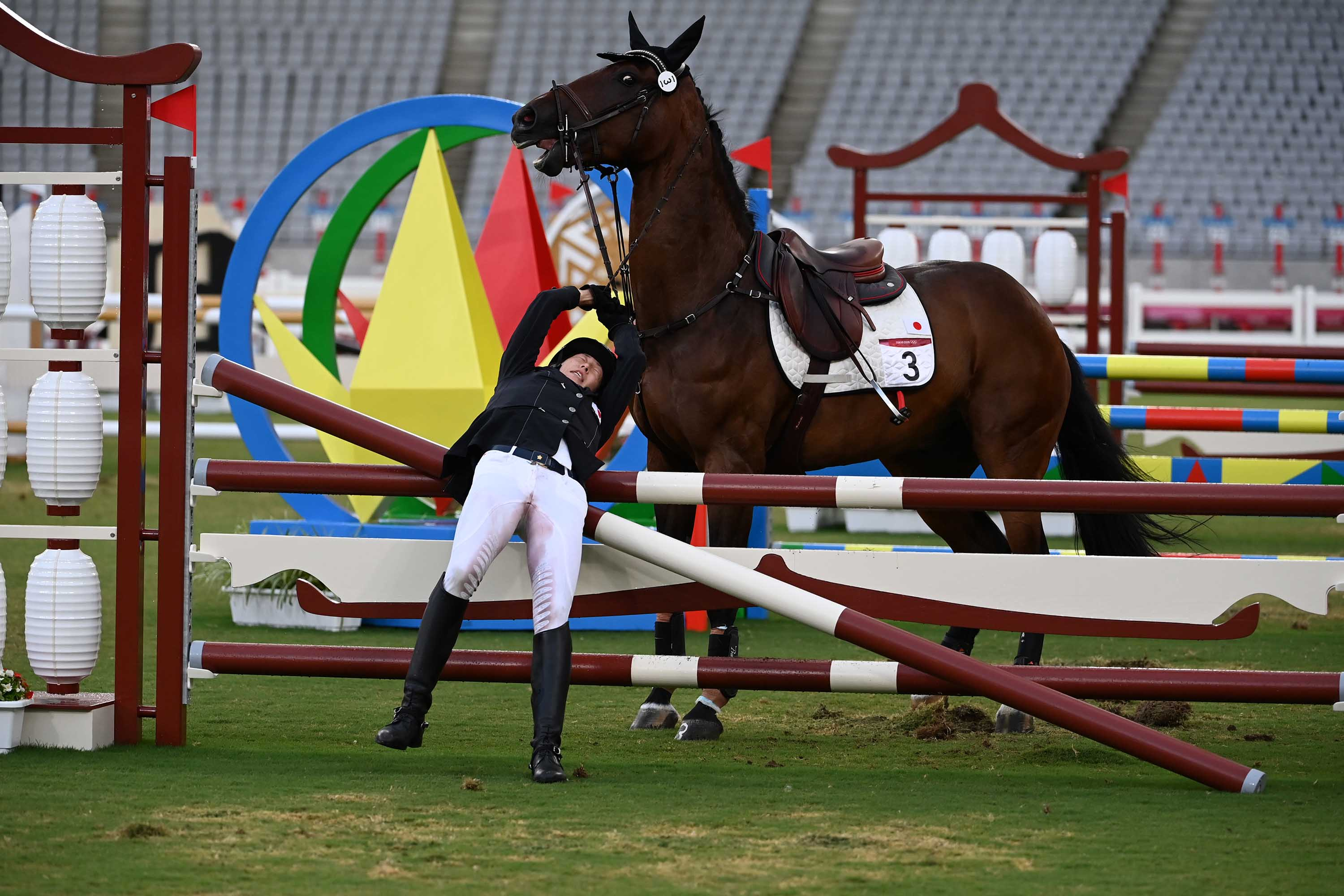 Annika Schleu of Germany falls after her horse refused to jump during the modern pentathlon on August 6.