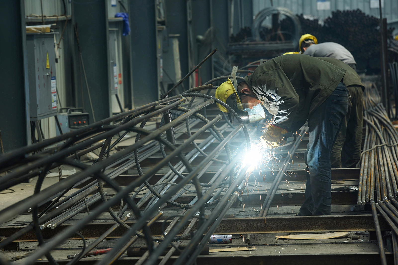 An employee works on steel bars at a factory in Hangzhou, in China's eastern Zhejiang province on May 15.