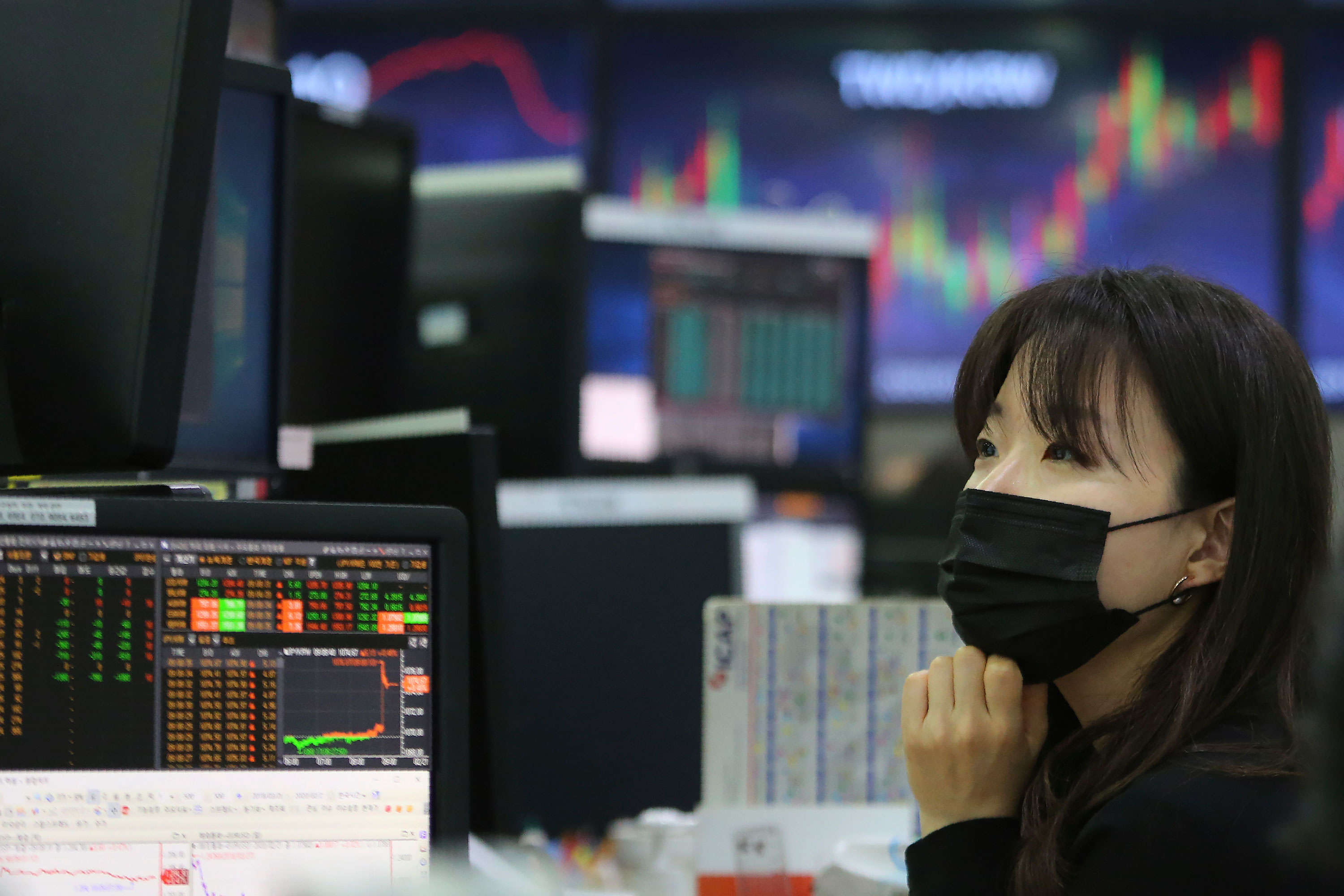 A currency trader monitors at the foreign exchange dealing room of the KEB Hana Bank headquarters in Seoul on February 21.