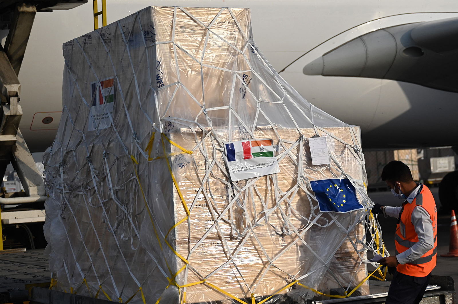 A ground staff unloads coronavirus medical supplies from France, upon the arrival of a cargo plane at the Indira Gandhi International Airport in New Delhi on May 2.