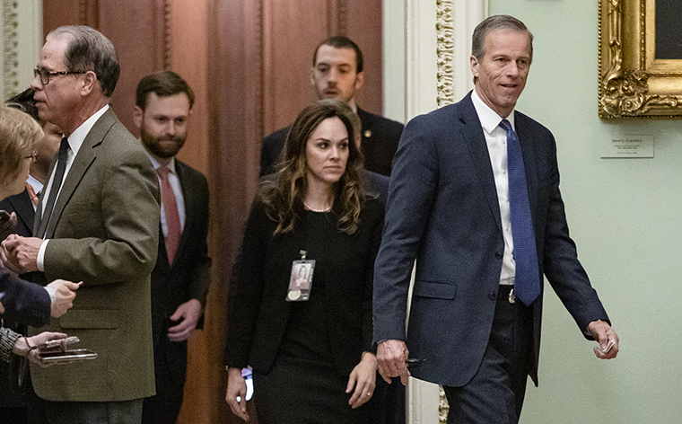 Sen.John Thune leaves the Senate floor for a dinner recess on Thursday, January 23.