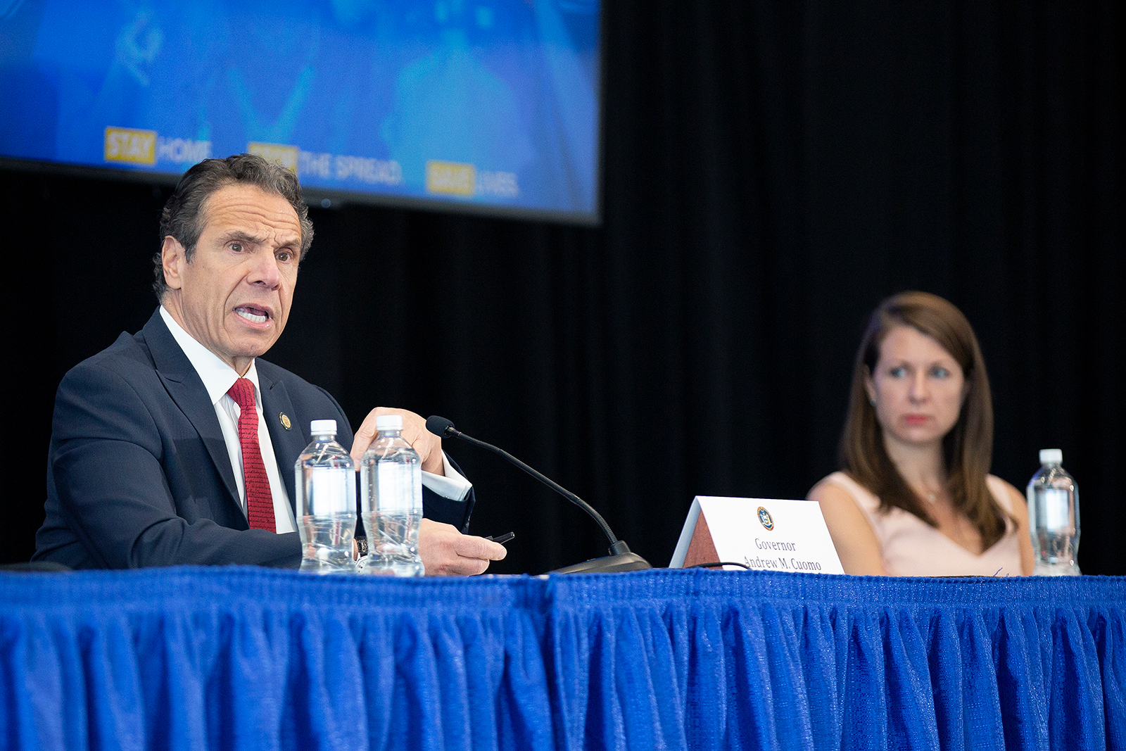 Melissa DeRosa, secretary to the governor, right, listens as New York Gov. Andrew Cuomo speaks during his daily coronavirus press briefing at SUNY Upstate Medical University on April 28, in Syracuse, New York.