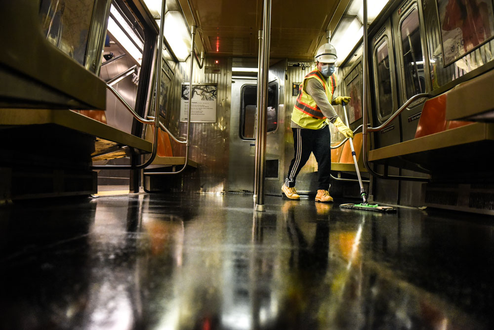 A cleaning crew member disinfects a New York City subway train on May 4.