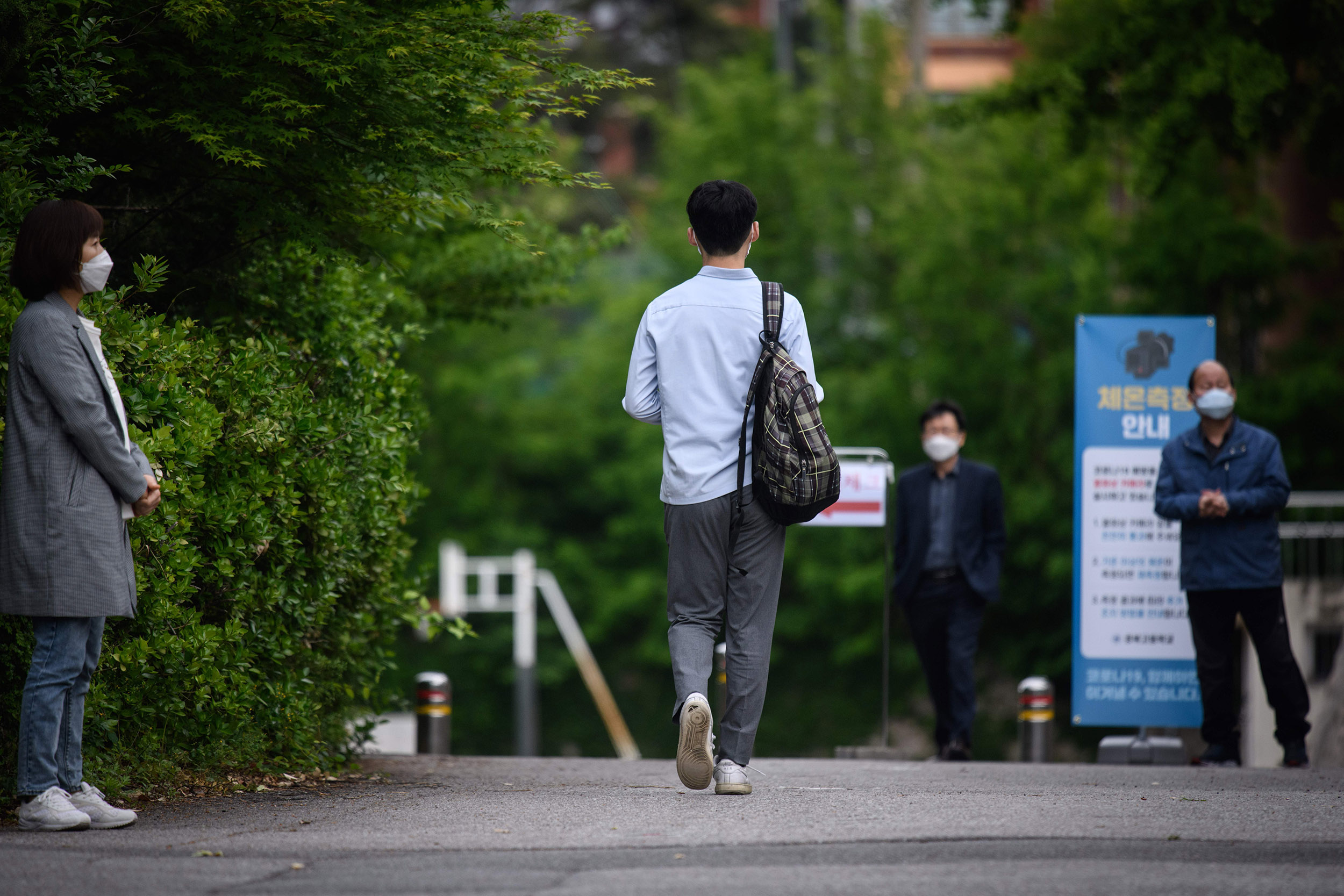 A student arrives at a high school in Seoul, South Korea, on Wednesday, May 20.