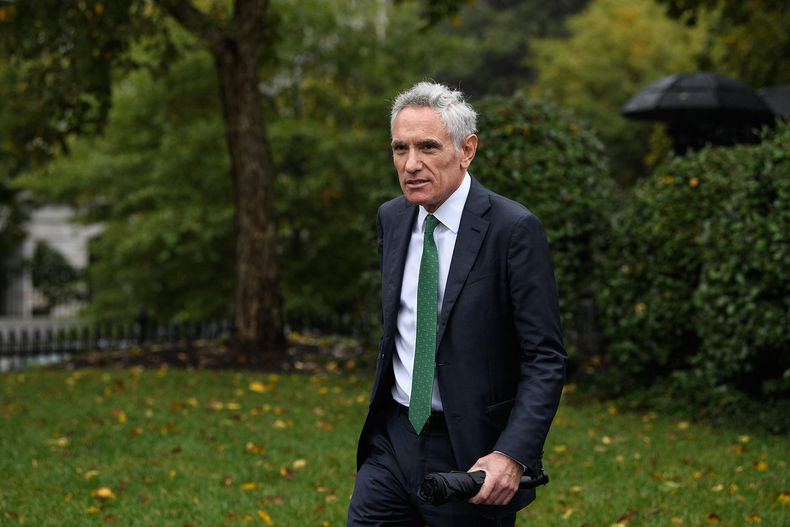 Dr. Scott Atlas, member of the White House Coronavirus Taskforce, walks at the White House in Washington, DC, on October 12.