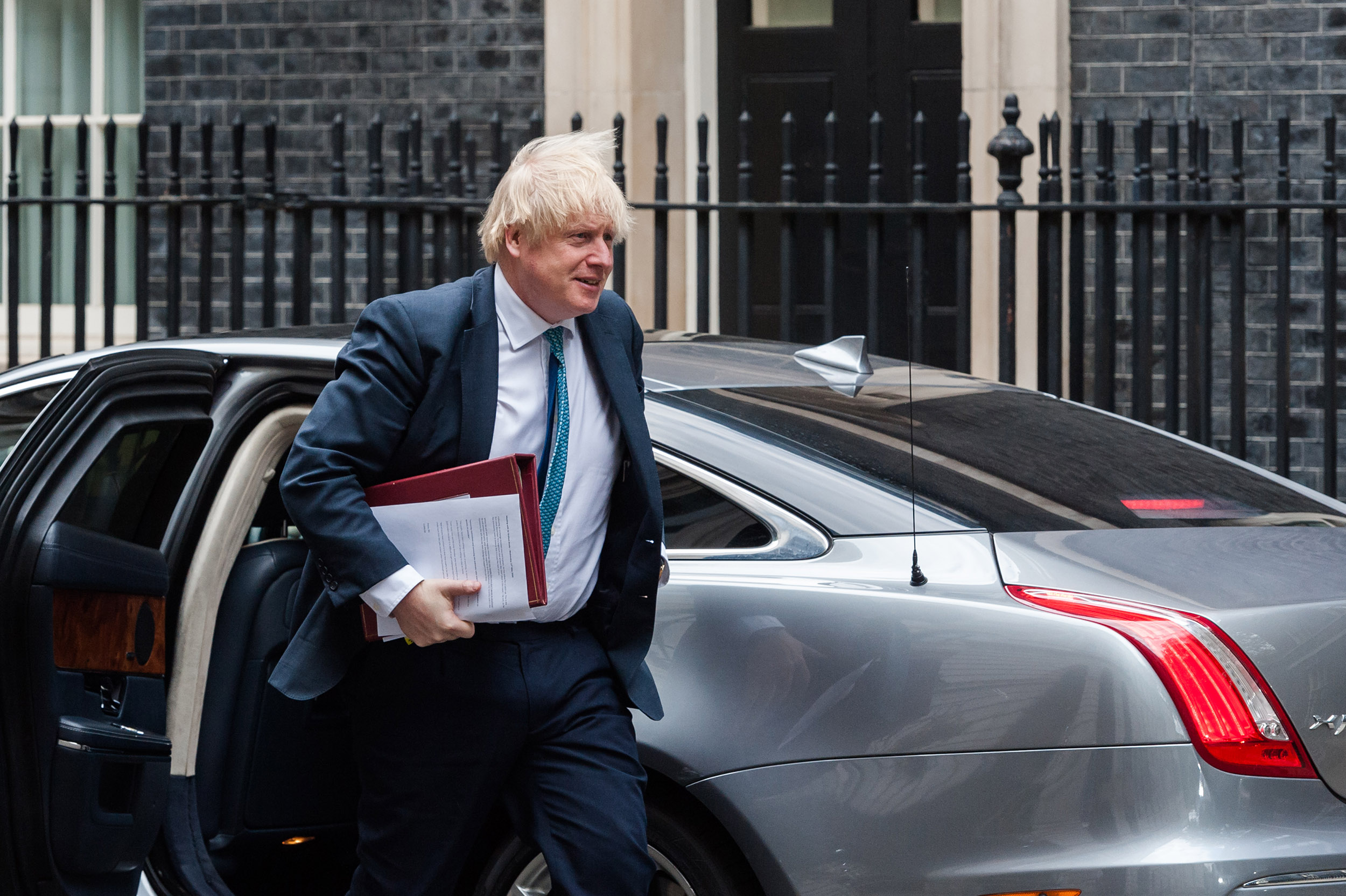 British Prime Minister Boris Johnson arrives on Downing Street after leaving the House of Commons in London, England, on Wednesday, May 13.