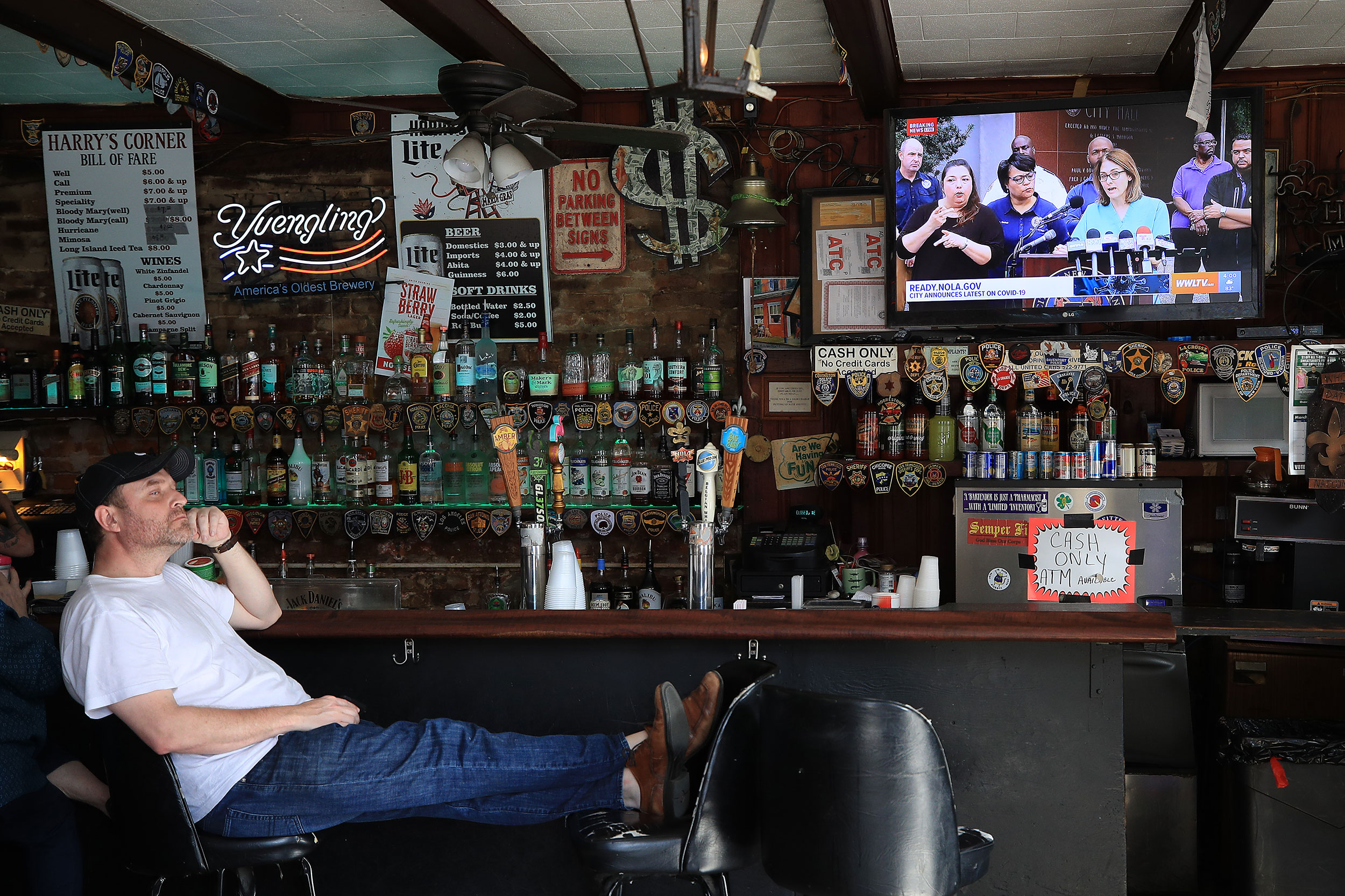 A man sits at a bar in New Orleans, Louisiana, on March 15.