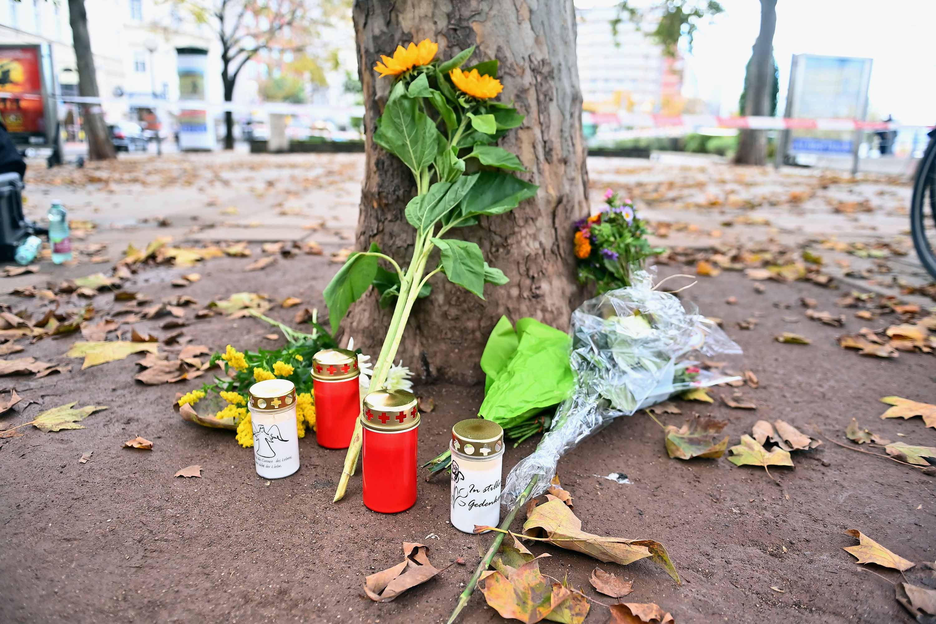 Flowers and candles are left for the victims of the attack at Schwedenplatz in Vienna, on Tuesday.
