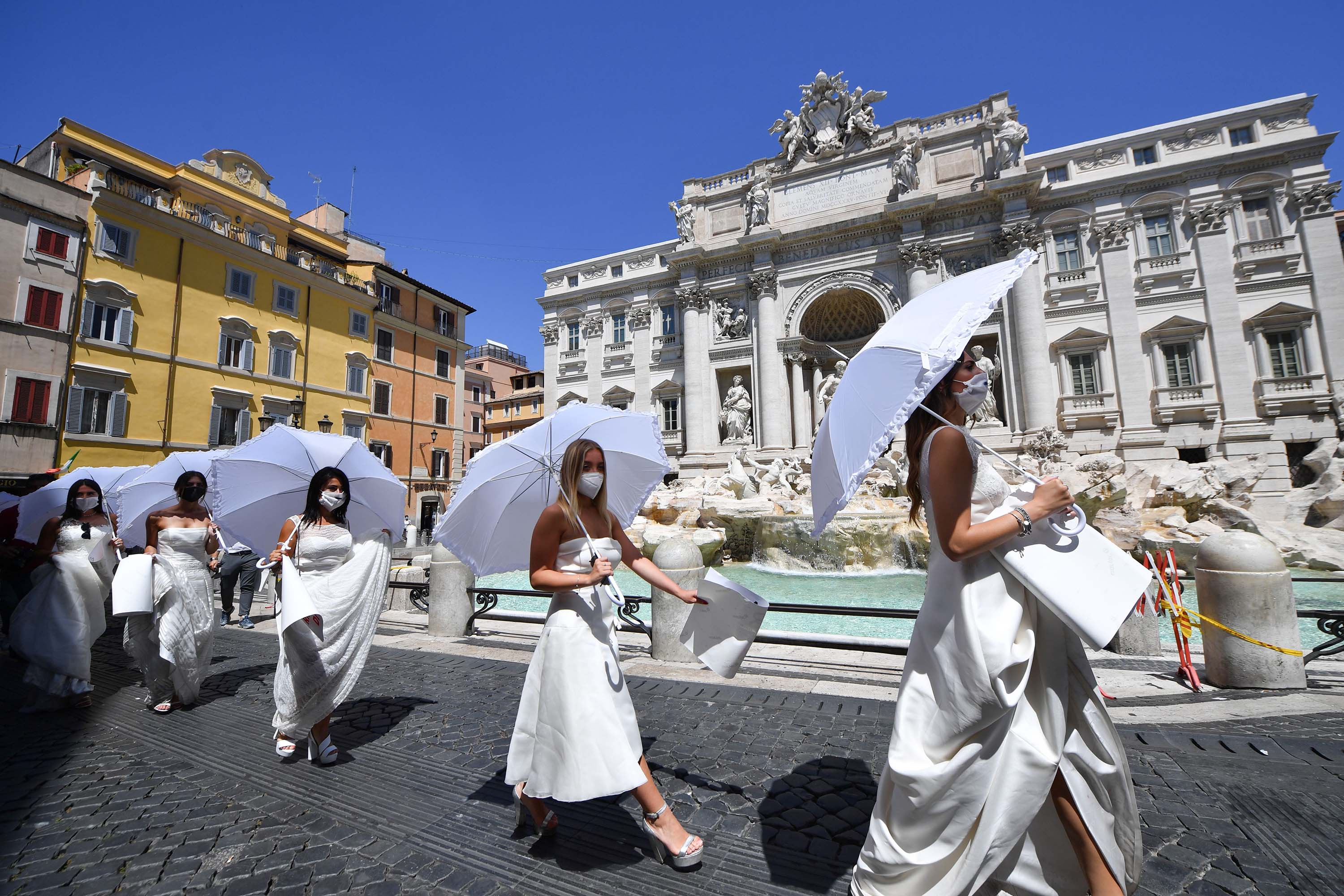 Women wearing wedding dresses stage a flashmob protest by the Trevi fountain in Rome, Italy, on July 7.