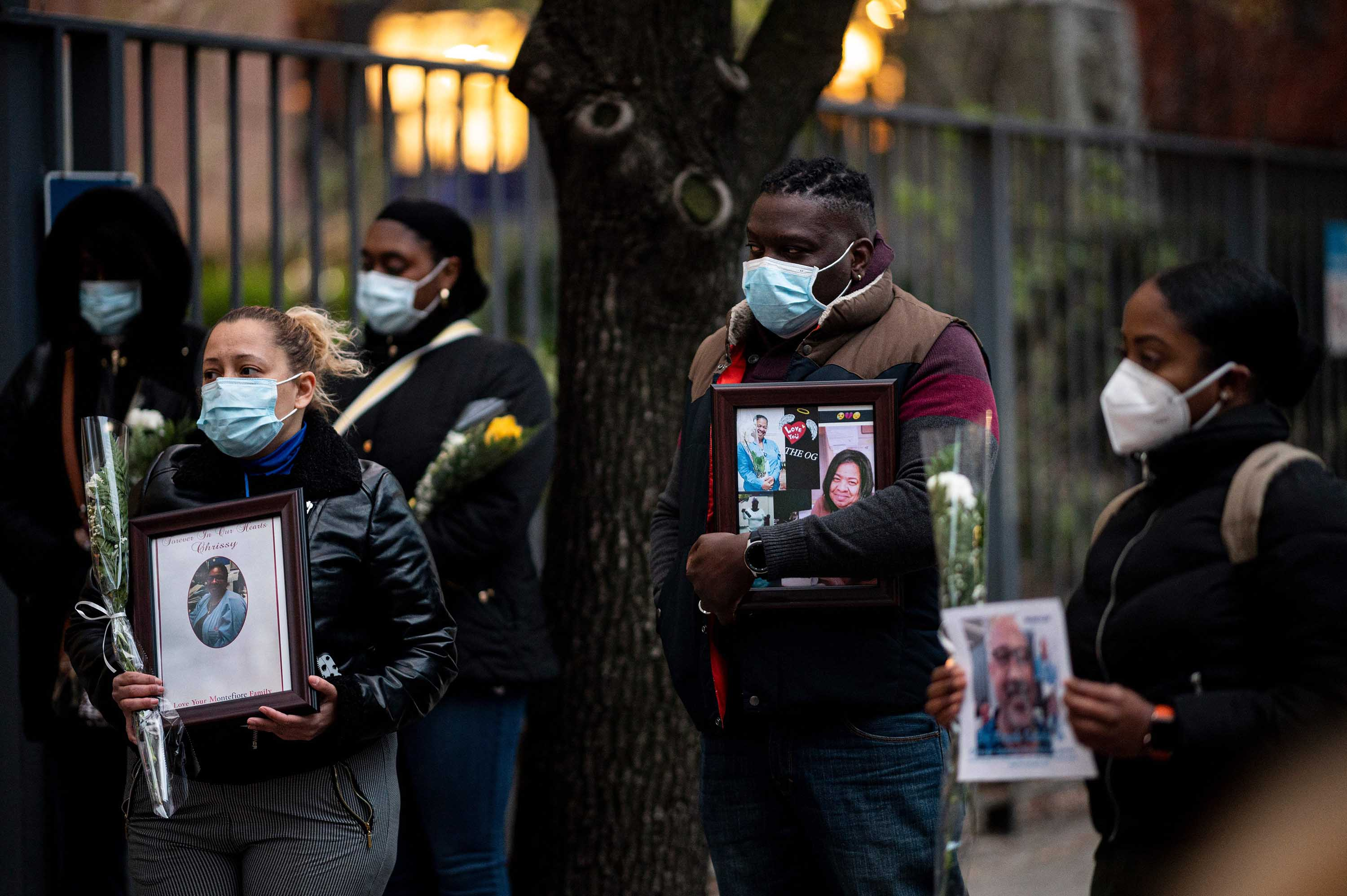Healthcare workers mourn colleagues who have died during the coronavirus outbreak at a demonstration near Mount Sinai Hospital in New York City on April 10.