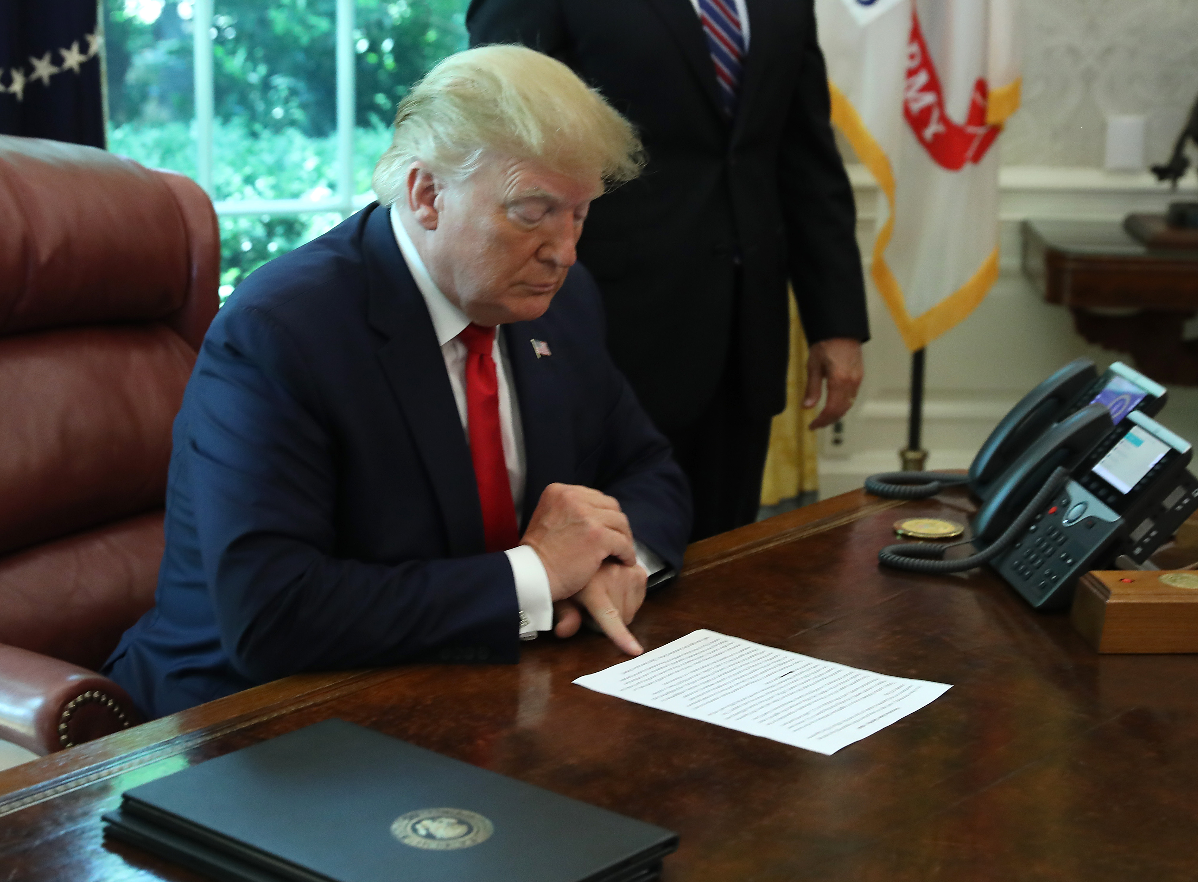 President Donald Trump signing an executive order imposing new sanctions on Iran on June 24, 2019.