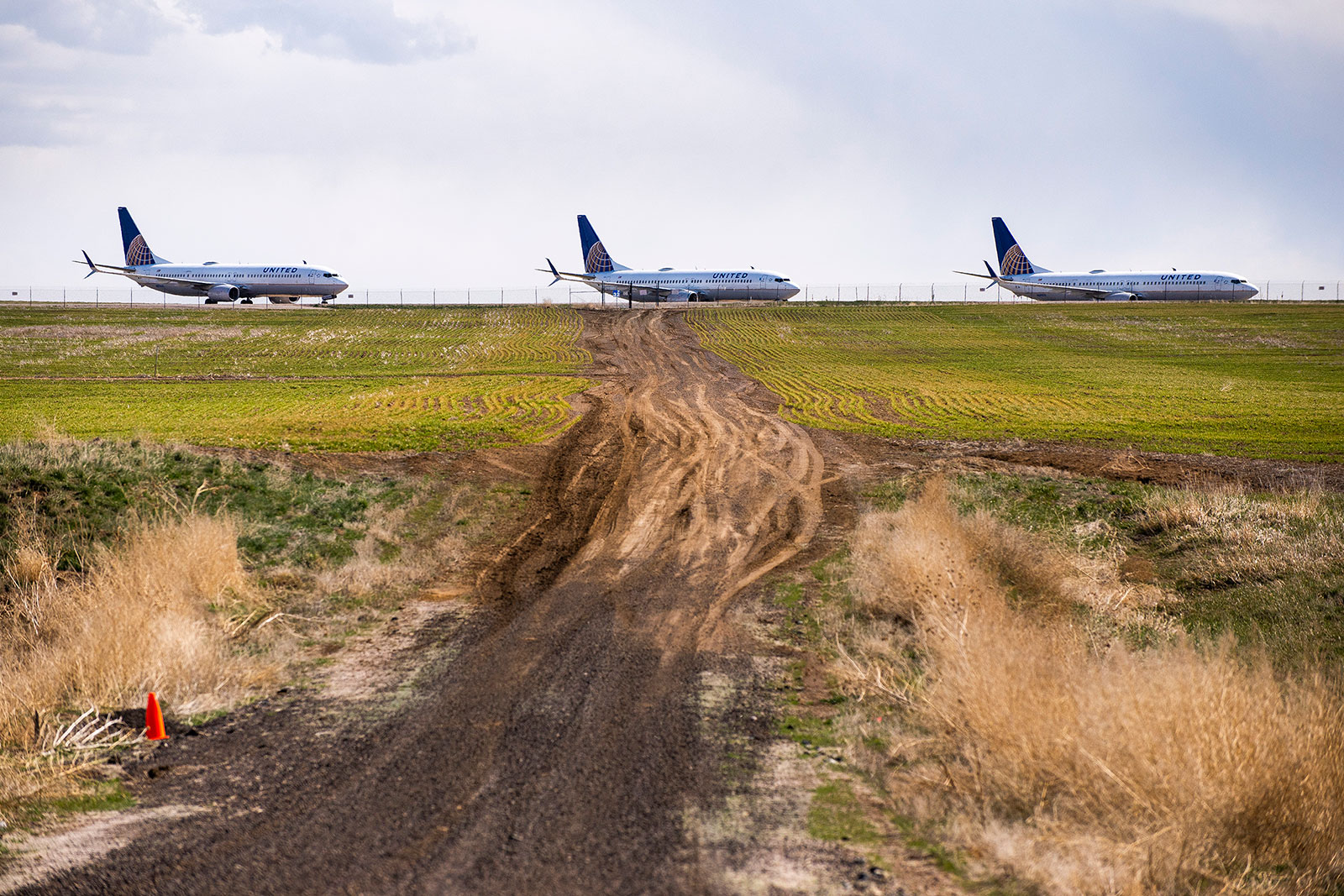 United Airlines planes sit parked on a runway at Denver International Airport.