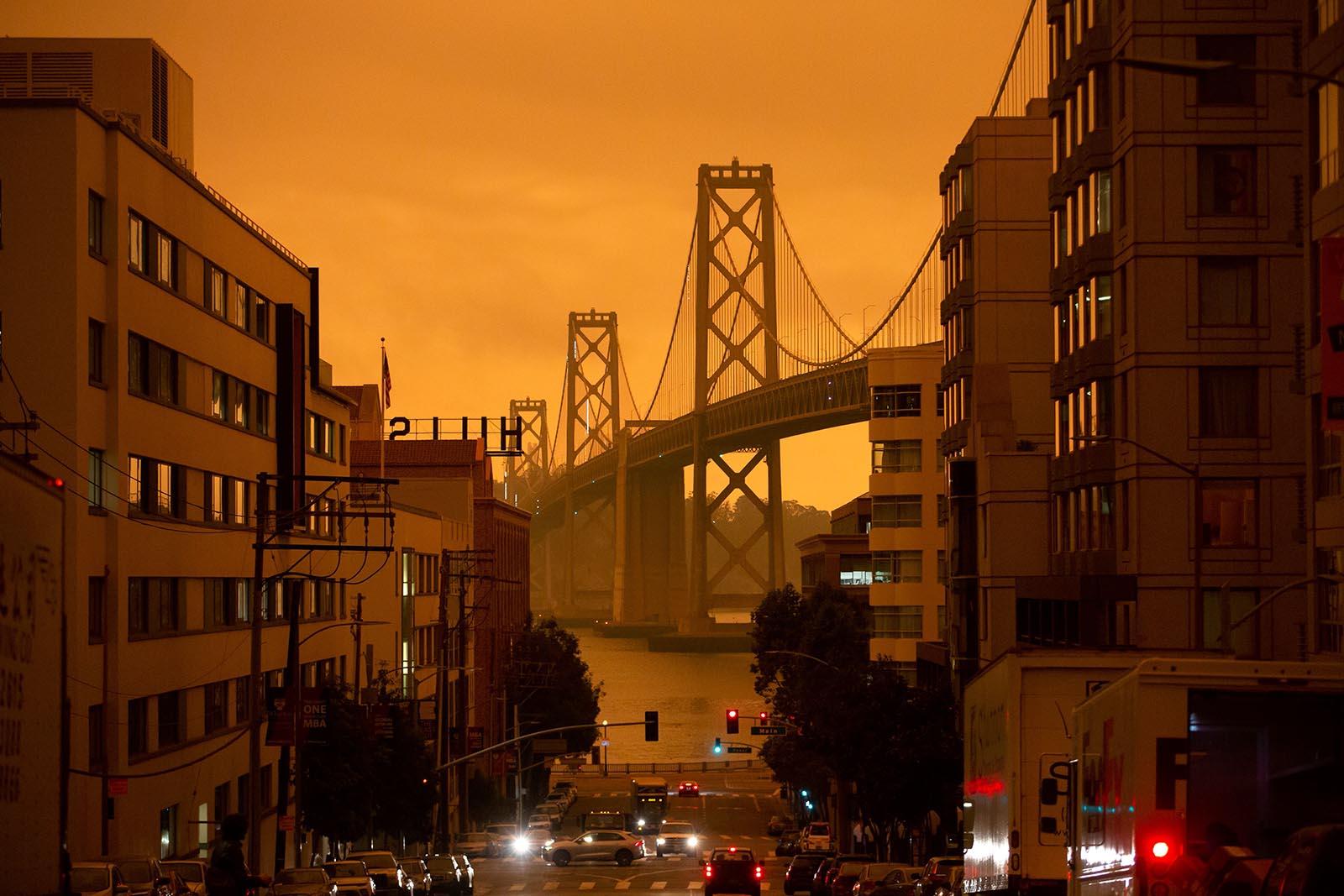 The San Francisco Bay Bridge is seen along Harrison Street under an orange smoke-filled sky in San Francisco on September 9.