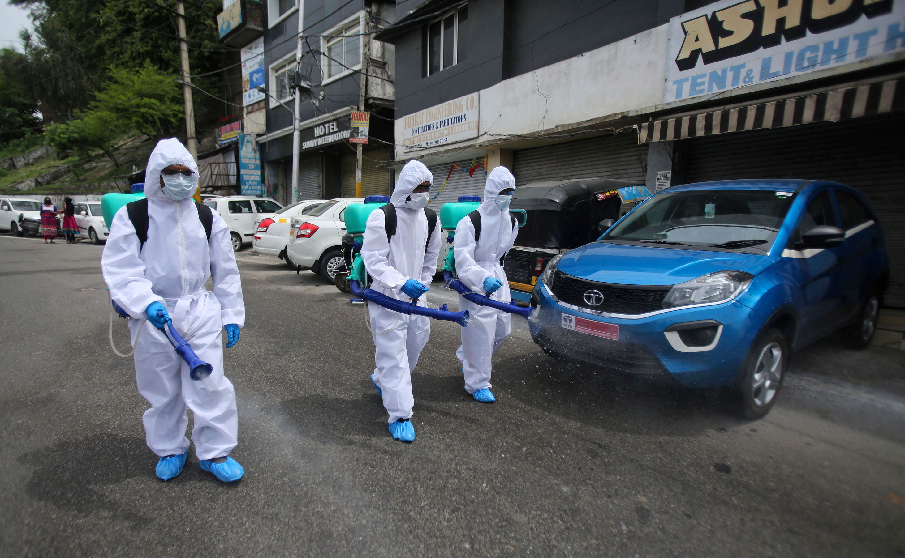 Municipal workers disinfect an area to prevent the spread of coronavirus in Jammu, India, on April 16.